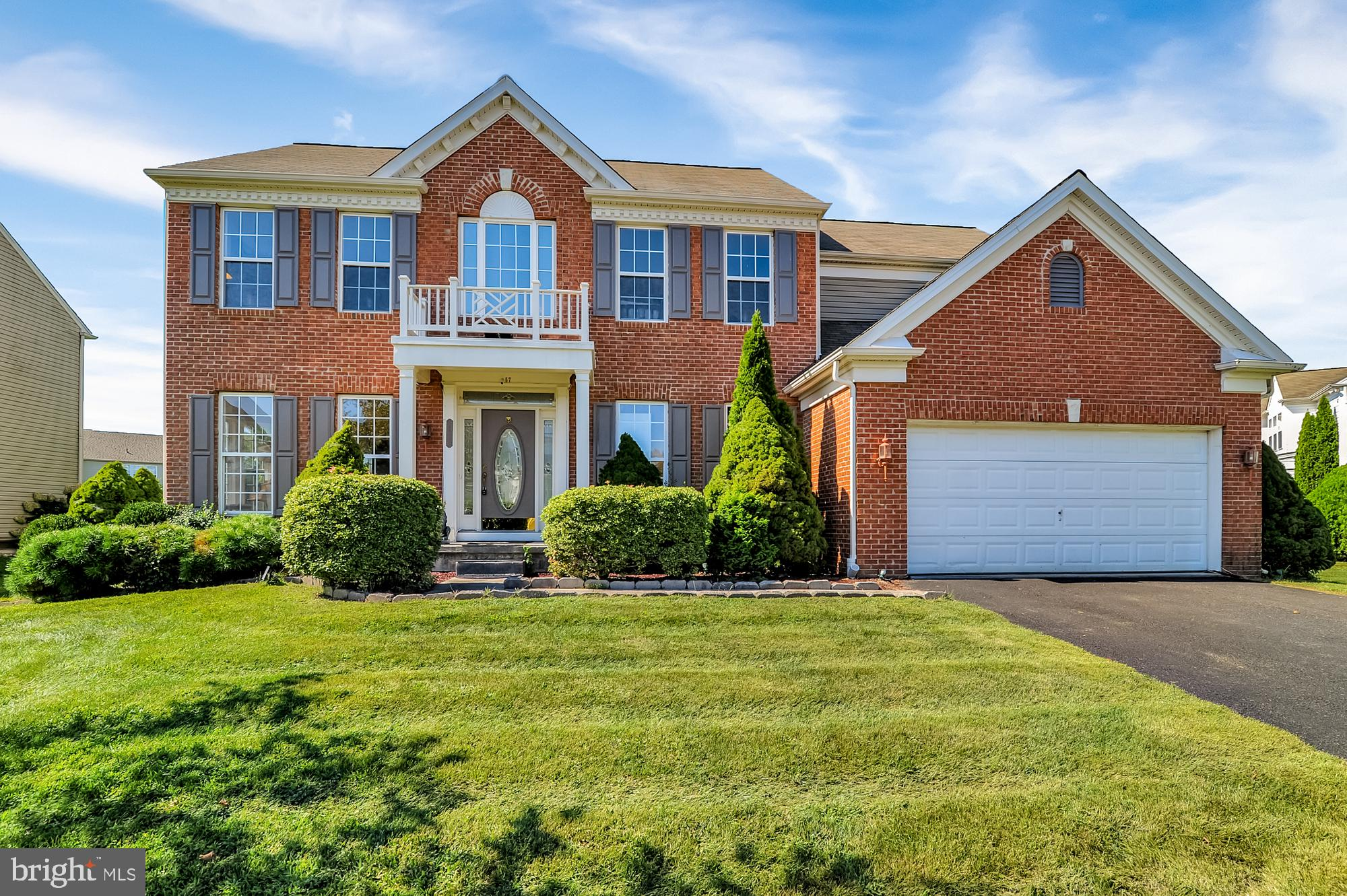 This traditional brick Colonial boasts mature landscaping and a handsome exterior that aims to please the most discriminating buyer. Once inside the two level foyer will wow you and your guests. Light and bright with a split staircase with catwalk at top looking down over the entryway. To your left is the formal living room with a picture window and fireplace. The dining area is perfect for entertaining, located between the formal living room and kitchen. The cook's kitchen features plentiful wood cabinets and endless prep space between the countertops plus the large island. Shiny hardwood floors enhance the design of this space. The island is perfect for a snack or quick meal and has room for four to sit at it. Off the kitchen is a large eating area with chandelier and sliding doors to the back patio. Beyond the kitchen and eating area is the large family room with another fireplace and a wall of windows to show off your gorgeous backyard. Retreat upstairs to your luxurious master suite! The en suite bathroom is spa-quality with a soaking tub, walk-in shower, and large vanity. The other three bedrooms feature wall-to-wall carpeting, ceiling fans, large closets and multiple windows for natural light. They all share a hallway bathroom with a tiled tub/shower combo and large vanity with plenty of room for storing all the essentials. The laundry room is conveniently located on the second floor too, complete with built-in storage space! There is additional space in the separate office, perfect for working from home or eLearning! Out back you have your own personal oasis with the brick paver patio complete with sunshade for those hot summer days. The yard is expansive and lined with a wall of mature trees for your privacy. Enjoy keeping your grounds gorgeous year round and saving money on your utility bills with the custom sprinkler system and private well! Click the link to take a virtual tour:  https://youtu.be/YqVhYRZyjCI