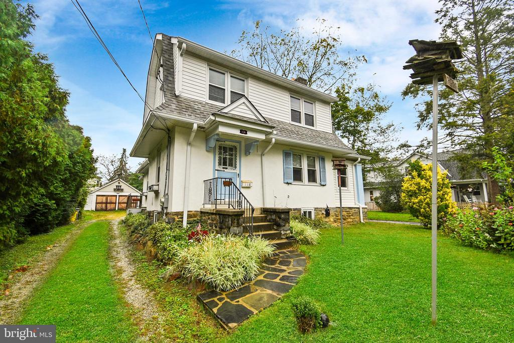 Located on a picture perfect tree-lined street in desirable Lower Merion Township, and offered for sale for the first time in 59 years is 116 Sutton Road. As the first house built on Sutton Road back in 1910, this property sits on one of the larger lots on the block and offers the main house, a detached two-car garage with overhead storage, and a large cinderblock shed. Upon entering through the front door, you'll be welcomed in to the oversized living room, which offers original hardwood flooring under the carpets, and a stone wood burning fireplace. Just off the living room is a small addition that would make for a perfect extra bedroom or home office.  Half of the formal dining room was converted to a full bathroom, while the other half still functions as a dining room and features a sliding glass door to the side yard by way of a concrete ramp. The kitchen is outfitted with recessed lighting, plenty of cabinet and countertop space, and laundry hookup. At the rear of the home is another full bathroom with bathtub. Upstairs are three nicely sized bedrooms, a large full bathroom, and an area that could be used as a small bedroom or nursery. The basement is completely unfinished, but offers an exit to the side yard as well as a toilet and laundry tub. The following items were installed new in late 2015; electrical panel, basement lighting, gas boiler, roof and plywood sheathing, various windows throughout the house, and the hot water heater. Just a short walk to South Ardmore Park and shopping at Suburban Square.