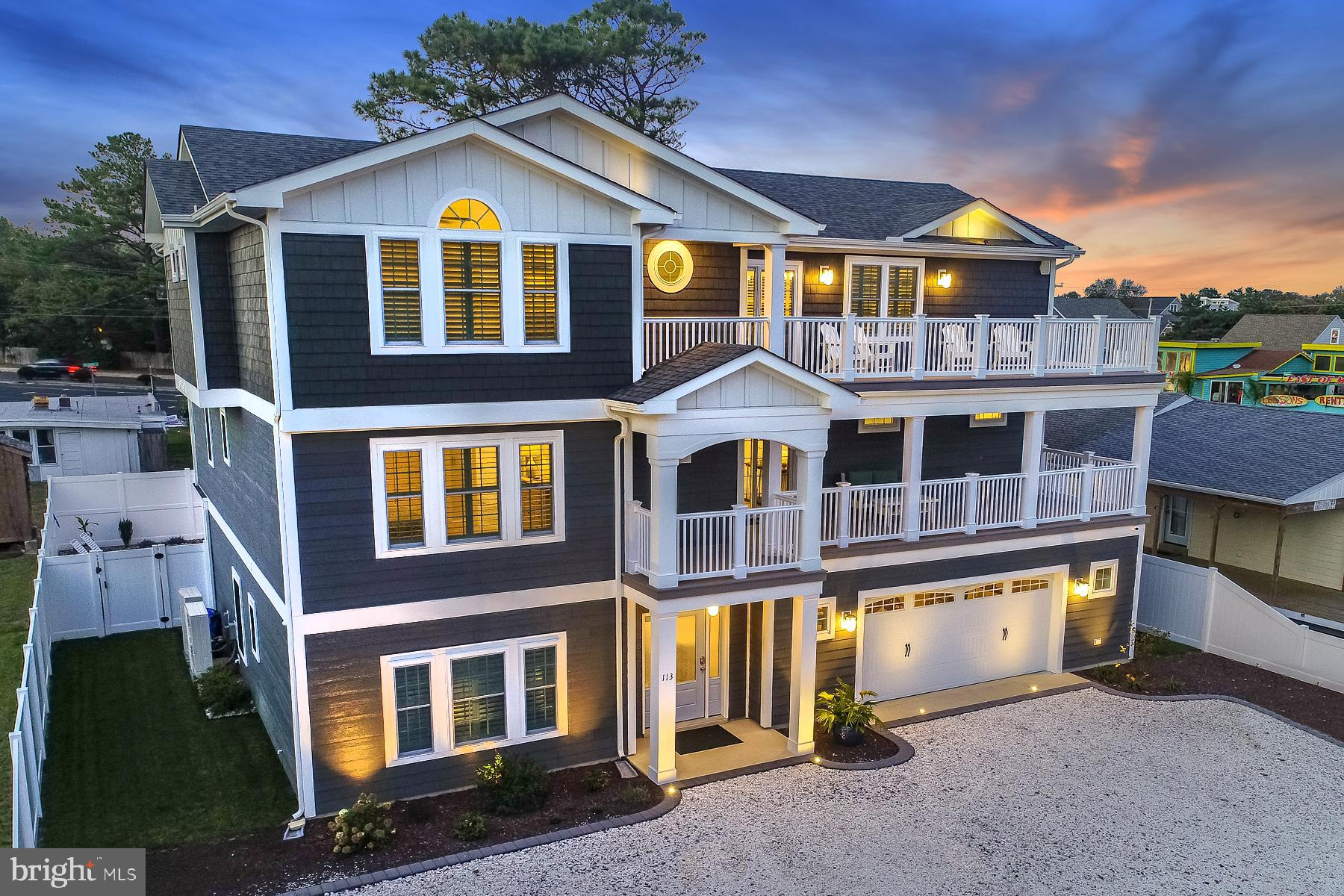 Introducing 113 Houston Street in Dewey Beach! This thoughtfully designed custom-built beach home offers stunning interior and exterior spaces with impeccable taste and high-quality features throughout. An inverted floor plan was designed to maximize the ocean views from the prime living areas, offering over 5,000 square feet of interior space and over 1,300 square feet of decks. Energy efficiency certified and expansion options for an office and up to 8 bedrooms and 7 full & 2 half bathrooms; ideal for large family gatherings and capturing the highest possible rental income as an investment property. Located just over a block to the ocean on an oversized (100x75) and high elevated lot (not in a flood zone) with 2 garage spaces and extensive off-street parking. No details were overlooked with an emphasis on entertaining and maximizing outdoor spaces. A rear oasis includes an extensive paver patio, in-ground pool, hot tub, built-in Tiki Bar, outside showers, privacy fencing, and a separate stairway leading to the second-floor master bedroom suite. The lower level features a partial kitchen, dining area, family room, wainscoting, and wood-look tile throughout. An elevator provides convenience with access to all 3 levels. The third level offers an open and airy floor plan complete with a true chef's kitchen including stainless steel appliances, dual wall ovens, oversized fridge, kettle faucet, two under counter ice makers, custom cabinetry, granite countertops, and a large island with a separate sink. The kitchen overlooks the dining area and family room with vaulted ceilings, gas fireplace and surrounded by windows allowing for an abundance of natural light. This space leads to a superb outdoor deck ideal for entertaining. The 2nd-floor master suite is exquisite with a walk-in closet, a spa-like bath with an oversized frameless glass and tile shower. Each bedroom offers direct access to a deck and bathroom. Additional home features include two Rinnai tankless water heaters, LP SmartSide siding, waterproof decking, vinyl soffits, two separate laundry rooms, and the list goes on! This home is being offered turnkey with new designer furnishings throughout. See attached list of features, construction specifications, and floor plans. Prime location and just a short walk to the beach, shops, restaurants, nightlife, and everything Dewey Beach has to offer. Ready for immediate enjoyment! Truly a must-see property.