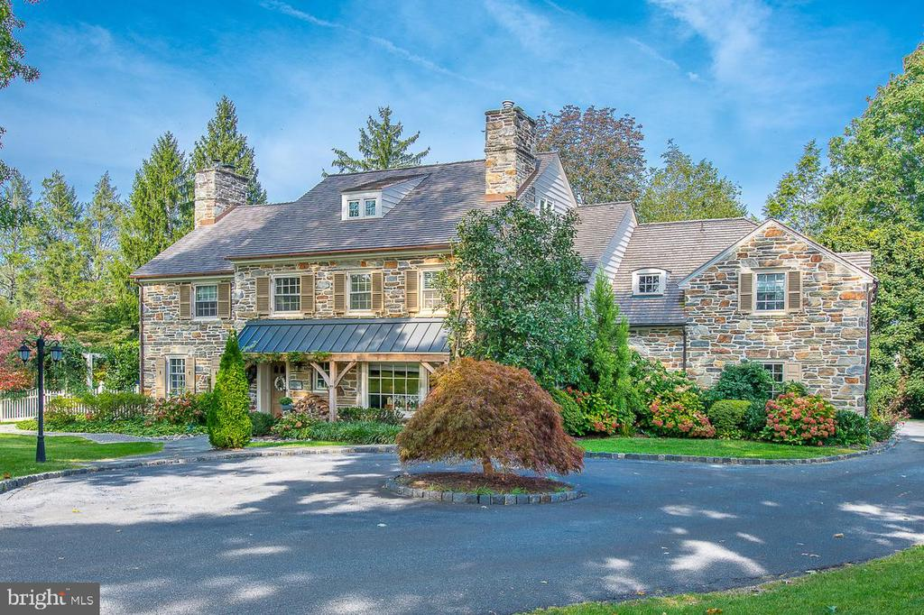 Stunning, stone, Main Line colonial on a private lane in one of Haverford's most coveted neighborhoods.  This beautiful property features lovely architectural details, well-proportioned sun-lit rooms and attractive landscaped grounds with a beautiful pool and outdoor entertaining spaces.  First Floor: large welcoming entrance hall with elegant staircase; living room with wood-burning fireplace and doors to patio; dining room with bay window; den/study with gas fireplace, bay window and built-in cabinetry; fabulous addition designed by Gardner Fox featuring a well-equipped kitchen with plentiful custom cabinetry open to breakfast room and family room with gas fireplace and doors to brick patio overlooking the secluded pool; formal powder room.  Second Floor: luxurious primary bedroom suite with bathroom and large his and hers walk-in closets; bedroom 2 with private bathroom; bedroom 3 with jack-and-jill bathroom to bedroom 4.  Third Floor: bedroom 5 with window seat; bedroom 6; hall bathroom.  Lower Level (which offers an additional approximately 1,000 sq ft of living space): second family room with wood-burning fireplace; temperature-controlled wine room; laundry room; gym; second powder room, unfinished area used for storage and a workshop.  This exceptional property is conveniently located for Merion Country Club and the shops of Haverford and is within an easy commute to Center City and Manhattan.