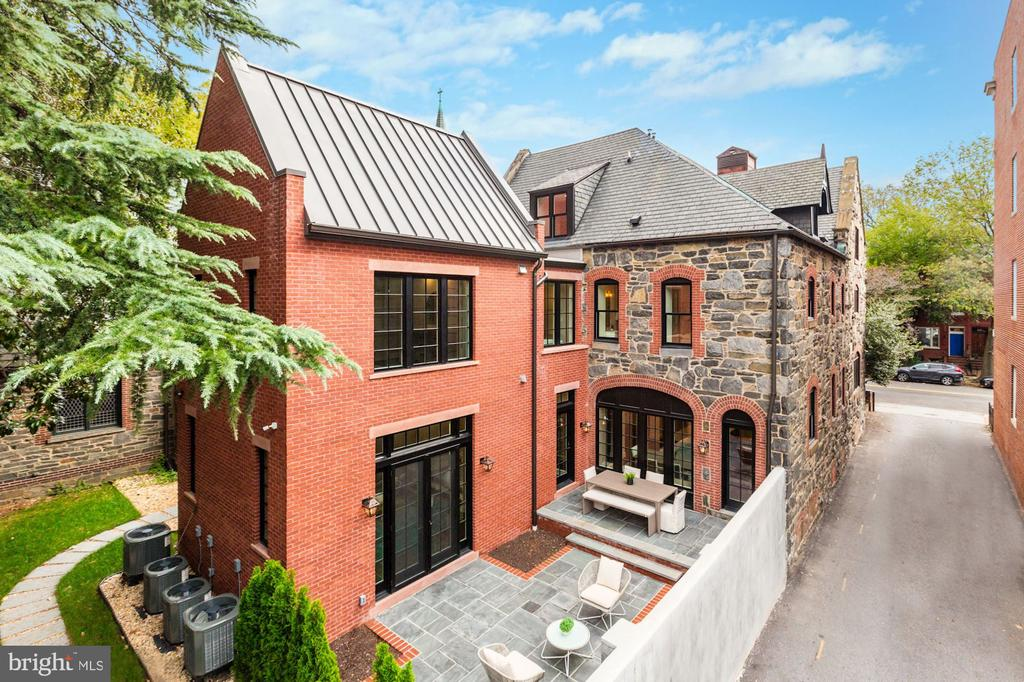 A timeless stone and red-brick facade shaded by mature landscaping captures the very essence of its charming setting, Historic Capitol Hill. Dating back to the late nineteenth century, Downing House was initially purposed as a church rectory for neighboring St. Monica and St. James Episcopal Church. The old church rectory has been completely reimagined to host two spacious luxury residences with every modern treatment and amenity. Spanning 4,100 square feet, Residence 2 offers 4 floors with 4-bedroom suites, 4 full bathrooms, and 1 powder room. The open chefs kitchen features a marble-clad island with a farmhouse sink, hand-milled cabinetry, Wolf & Bosch pro-series appliances, and fine glazed coffered ceilings, which add handsome architectural nuance to the main living spaces. Refinement is evident from every angle. From Bevolo lanterns to lacquered doors and banisters, hefty hardware and plumbing fixtures, flawless tile and masonry work, and rich solid oak hardwood flooring. The subtle handiwork of countless artisans is on display. Downing House is guaranteed to exceed the market standard. Plentiful custom paneling and soaring ceilings assure the feeling of grand-scale city living. Top-of-the-line audio/visual components were diligently installed throughout. Each bedroom is paired carefully with an en-suite bathroom and custom-milled closets. A long dramatic hallway welcomes residents to the inspiring master suite boasting 13-foot vaulted ceilings, a bath drenched in marble with a freestanding soaking tub, and a massive walk-in master closet. A large hardscaped private patio and garage parking complete the picture. Constructed with integrity by Berkeley.