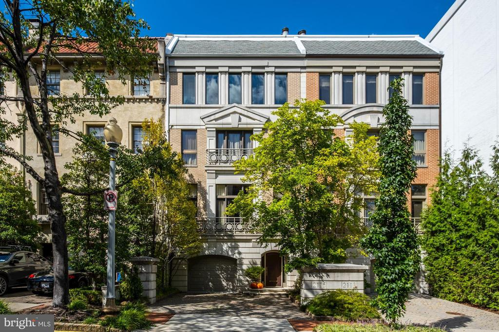 Incredible and striking 4-level townhome in historic Kalorama neighborhood w/ 4BR/4BA/2HBA. Entry level features and elegant foyer with elevator access (to all levels of home), access to attached 2-car garage, laundry rm & wine cellar. Main level boasts gleaming HWF, detailed moldings & fts. large 3-story Atrium w/  wrap-around staircase & expansive skylight 30ft above. 11ft+ ceilings throughout formal LR, DR & gourmet kit. Owner suite fts built-ins, ceiling fan, Juliet balcony, wood-burning FP, crown/base molding, luxury en-suite BA & walk-in closet. Family rm on top level fts ceiling fans, built-ins, wood-burning FP, wet bar, & powder room.  Landscaped private balcony and walkable to daily errands, fine dining & more!