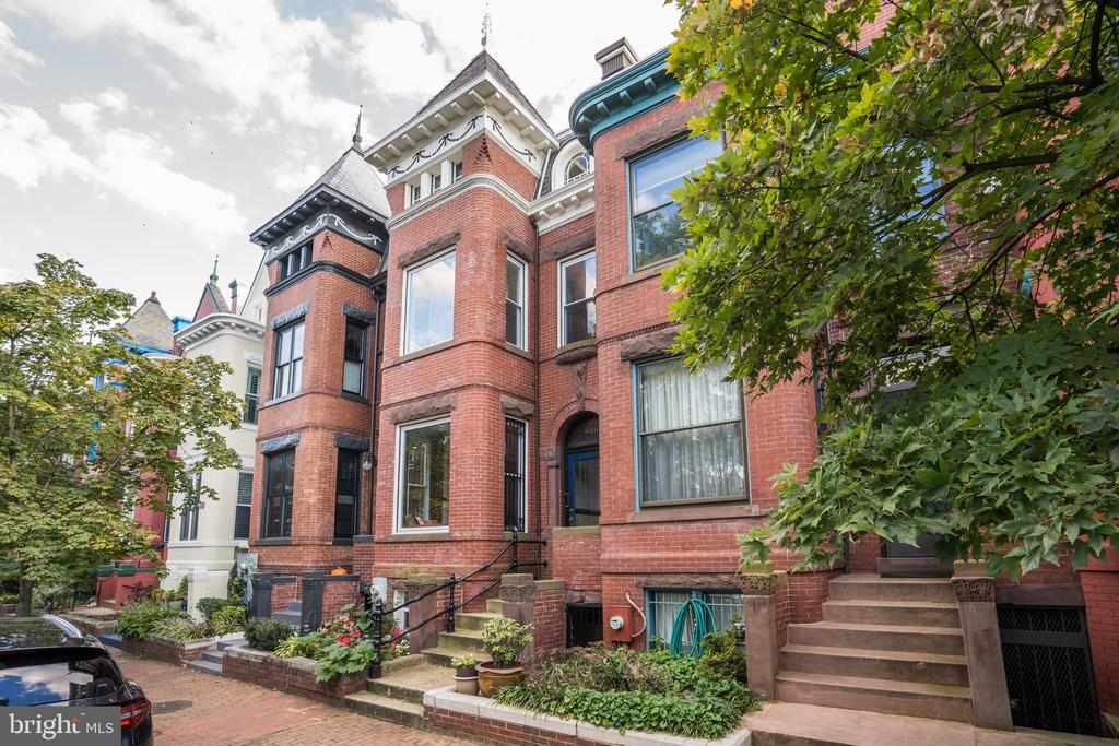 """Don't miss this classic Grand Dame on coveted Westminster Street! Statuesque 3.5 floor row home offers historic architectural details, including beautiful and rare heart of pine wood floors throughout (even under the carpets), tall ceilings throughout, original wood detailing, pocket doors, and 4 original fireplace mantles. The main floor includes a formal living room, formal dining room, bright kitchen, grand stairway with original wood banisters, and full bath. Upstairs, the bedroom level features three spacious bedrooms, and two updated full bathrooms. The larger bathroom with glass shower also has heated floors. Above the bedroom level lies a suite, thoughtfully renovated with exposed brick walls, skylight, and large storage closet. This room is an ideal space for guests, and is fully wired for a home office. The spacious lower level, with front and rear entrances, has high ceilings and has been partially finished with an entertaining space, and the vast back room provides optimal storage and workspace, and laundry room. The room divider, enclosure and barn door are handmade/selected from reclaimed chestnut. This space could easily be converted to an apartment, as it has been roughed in for a bathroom. Additionally, enjoy the privacy of garage parking! This magnificent home was meticulously maintained and updated by the current owners, and truly upholds its' historic elegance. Located in the heart of Shaw, just steps from restaurants, grocery, and transportation. Westminster Street is a one block """"hidden gem"""",  complete with its own coveted and gated playground! Key Features: Beautiful Heart of Pine wood Floors Throughout, Including Under Carpet, Roof Replaced in 2016, Roof Turret Recovered in Slate, Two Top of the Line HVACs and Water Heater installed in 2016, Ornamental Architectural Details on Exterior, Railings and Turret Restored at great cost, Original Wood Detailing on Banisters and Door Frames, Heated Floors in Larger Full Bath, Full Basement with High C"""