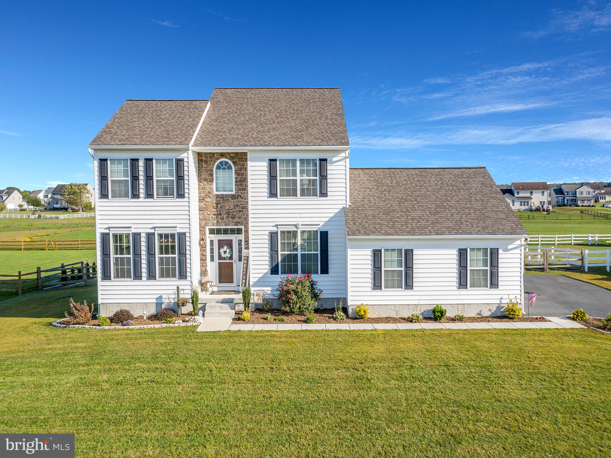 Visit this home virtually: http://www.vht.com/434110571/IDXS - Welcome to 385 Jockey Hollow Drive!!   This captivating home welcomes you with 2,662 SqFt of care-free living space. This home sits on a premium location that offers nothing but peaceful common ground behind your .66-acre lot. The backyard includes a large deck and fire-pit, perfect for entertaining. This well-maintained home features 4 bedrooms and 2 1/2 baths, with a spacious open floor plan and bright natural sunlight.  The main level features beautiful vinyl hardwood throughout. The kitchen features granite countertops, stainless steel appliances, ample pantry and counter space, with a perfect view into the living room. The living room provides natural sunlight, a cathedral ceiling and a fireplace to cozy up next to.  The sunroom, also located off the kitchen, makes the perfect bonus room with endless possibilities.   Upstairs you will find 4 spacious bedrooms with carpet, updated ceiling fans and neutral paint. The primary bedroom includes its own bathroom, walk-in closet and gorgeous accent wall. You will also find the laundry in the upstairs hallway.   The extended 3-car garage is just another great addition to this home, giving you more room for parking, storage, etc.  This home is also located in a USDA area which means you could get 100% financing!  Put this home on the top of your list. It will not last long!