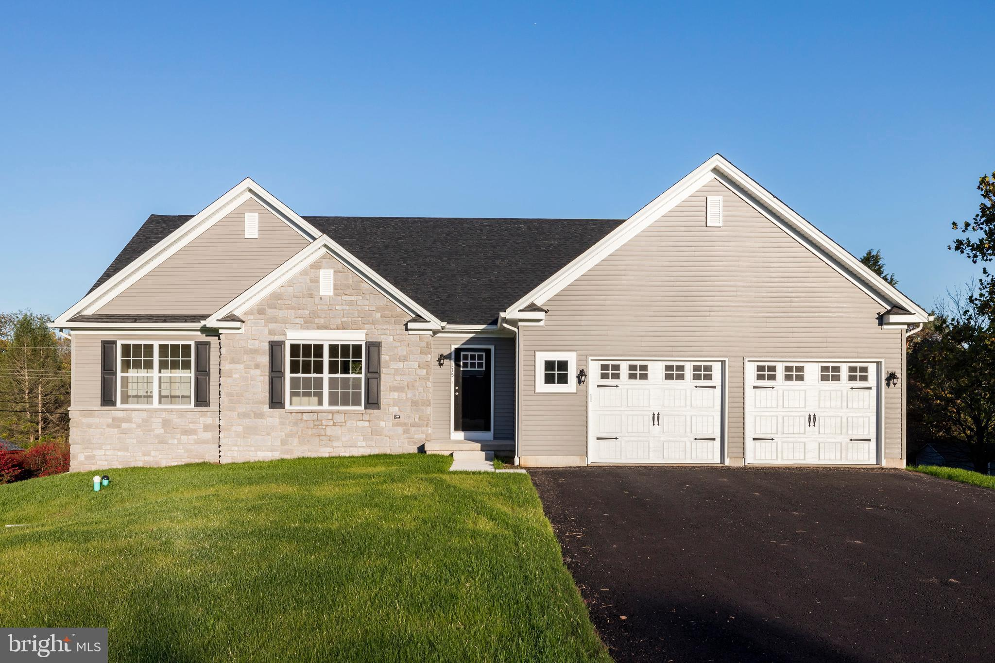Immediate occupancy available at this NEW CONSTRUCTION ranch home! Enjoy true one floor living with no HOA fees on a half acre lot in a charming neighborhood in Lower Pottsgrove. A nice wide driveway leads to an oversized 2-car garage with beautiful barn-style doors. You can choose to enter through the garage into the mudroom/laundry room, or come in through your striking modern front door into a foyer with double coat closet. A large sun-soaked living room flows into a beautiful eat-in kitchen with real wood cabinetry, quartz countertops, island with trash drawer and electric, recessed lighting, stainless appliances, and an enormous walk-in pantry. The eat-in area is very roomy and offers access to the buyer's future deck overlooking the private rear yard. Just past the laundry room is the spacious and private en-suite bedroom with large walk-in closet and bathroom with walk-in shower, linen closet, and double vanity.  The other side of the home offers 2 additional bedrooms, both with 2 double closets, that share a full hall bath with tub surround and single vanity for wheel chair friendly access. The lower level is ready to finish and offers walk-out egress and potential for additional living space. There is so much to love and so little worry with brand new mechanicals, a sprinkler system, PEX plumbing, and the intentional luxury of being able to age in place! Come see this brand new beauty before it's gone!