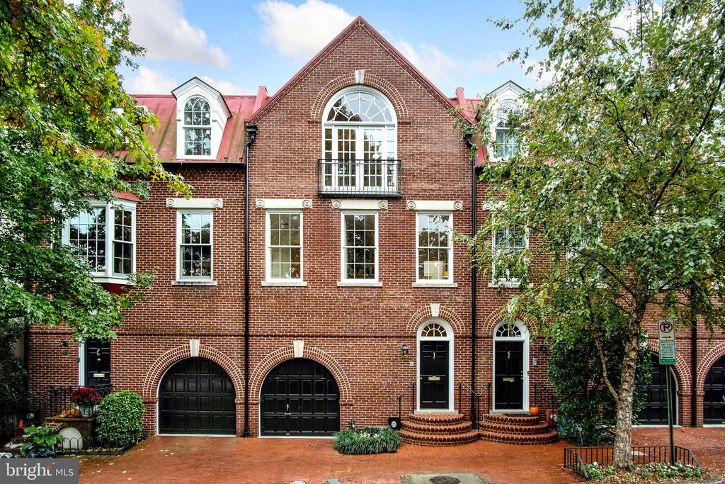 This federal style home situated in the heart of Georgetown's West Village was designed by Robert Bell. The home offers beautiful spaces for entertaining including a grand Living Room with bay windows and bar area, a large Dining Room with fireplace which connects to the eat-in Kitchen and enjoys access to the rear Patio/Pool. Sunlit Owner Suite features high ceilings, Sitting Area with fireplace, en-suite Full Bath, and gorgeous views of the rear yard. Bedrooms 2-4 all enjoy their own Full Bath. Complete with a private Patio and Pool,  Elevator, and 1-car Garage. Total Square Footage of home: 3,630 sq.ft. Open Sunday 1- 4 PM.