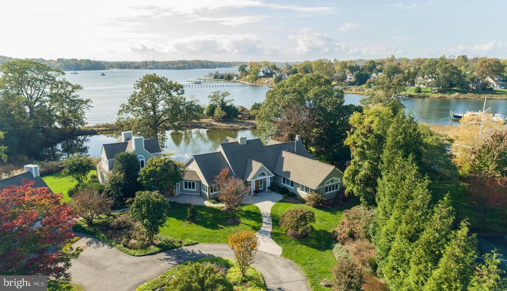 """Exceptional once-in-a-lifetime opportunity to own a glorious waterfront property on sought-after Melvin Road in Annapolis, Maryland.  Surrounded by multi-million $ homes, this 2.6-acre ultra-private waterfront estate with 1,000 feet of South River waterfrontage is a true """"Legacy property"""".  Enjoy sweeping western facing views of the South River and Little Aberdeen Creek, the perfect setting to celebrate the waterfront lifestyle.  One rare and highly unique feature is the small peninsula with private gazebo which connects to the property by a charming arched foot bridge.  Mature trees and gardens provide natural screening which create a true sense of privacy.  This 5,000+ sq ft coastal-style home with 5 bdrms, 5 baths, 2 master suites, waterside patio and  3-car garage is warm, inviting and totally turn-key.  Alternatively, for those who have something custom in mind,  this exquisite setting may offer the perfect canvas for you to build your dream waterfront home.  Feel like you are on vacation every day with fabulous amenities including an expansive pool with waterfall, hot tub and a massive 100' x 200' sport/tennis court.  The private deep-water pier complex with 8ft water depth is decked out with (4) boat lifts, 25,000 lb, 15,000 lb, dingy lift, floating jet ski lift and (2) 50amp shore power pedestal stations, perfect for the boating enthusiast.  Location, Location, Location! Just 10 minutes by boat to the Chesapeake Bay or by car to Historic Annapolis and a mere 30 minutes to D.C. or Baltimore.  This is the ONE!  Don't let this opportunity slip away.  To explore the property without leaving your home, be sure to view the HD Video Tour:  https://youtu.be/A83psd4EWM4"""