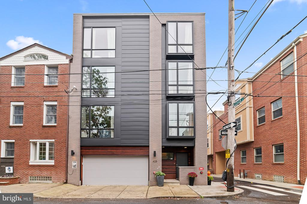 Stunning 4 year old construction with side by side 2 car garage parking. This 30 foot wide corner property was meticulously built by one of Philadelphia's premier builders, Callahan & Ward.  Remarkable exterior with floor to ceiling windows throughout.  Enter through a covered entryway which leads to a foyer area that includes a powder room and full size coat closet.  Take the stairs to the 2nd floor to find a spacious  living area-  complete with a high-end kitchen, dining and living room with a gas fireplace, and a bonus built in home office.  This level of the home really materializes the great light flowing through 3 substantial floor to ceiling windows. On the 3rd floor you have 2 generously sized bedrooms, and 2 full bathrooms.  The 4th floor features a full floor owners suite!  You will find a luxurious spa-like bathroom with a large soaking tub, and an oversized walk-in shower. A large walk-in closet with built-ins, and a separate den area with a wet bar completes this top-tier suite.  Up to the spacious roof deck where you will discover unobstructed skyline views, and plenty of privacy.  Also included in the layout is a finished basement with high ceilings, perfect for an extra den space or a flexible bedroom space.  All of this located on a quiet block of one of Philadelphia's most exciting and vibrant neighborhoods, Northern Liberties.  Just steps from Liberties Walk, The Piazza, and the 2nd Street business district.  The location also provides easy access to I-95, I-676 and the Ben Franklin bridge.  Also, over 4 years left of tax abatement! Don't miss out on this one of a kind opportunity!