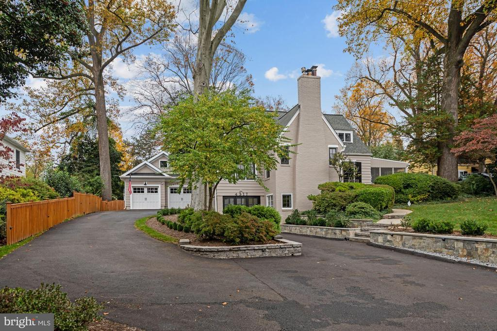 Traditional charm and contemporary updates blend seamlessly in this three-finished-level Colonial with storybook curb appeal on a picturesque 1/3 acre, tastefully renovated and expanded in 2018. A winding stone walkway leads to the entry, which opens to a dramatic family room with 2-story vaulted and beamed ceiling. Off the family room is study/office flooded with light. A bright, contemporary kitchen overlooks the backyard. French doors from the dining room lead to a magnificent screened porch. Along the back of the home is a beautiful first-floor owner's bedroom with renovated bath and enormous, custom walk-in closet. Winding stairs lead to the 2nd floor with three good-sized bedrooms and ultra- charming sitting area/reading nook. The fully finished lower level includes a workout room, half bath, rec/family room with gas fireplace, and a bedroom with exit to a mudroom/storage area. An expansive flagstone patio with stone firepit and sitting wall allows for delightful entertaining. Don't miss the oversized 2-car garage, so artfully finished it could also serve as an artist's studio or an office. Modern updates complement classic features and lovely original detail throughout … all moments to the Marc Train, Antique Row, the farmer's market and shops and restaurants of Old Town Kensington.
