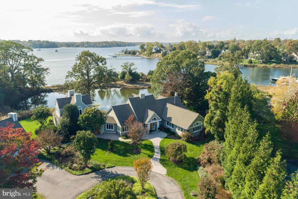 "Exceptional once-in-a-lifetime opportunity to own a glorious waterfront property on sought-after Melvin Road in Annapolis, Maryland.  Surrounded by multi-million $ homes, this 2.6-acre ultra-private waterfront estate with 1,000 feet of South River waterfrontage is a true ""Legacy property"".  Enjoy sweeping western facing views of the South River and Little Aberdeen Creek, the perfect setting to celebrate the waterfront lifestyle.  One rare and highly unique feature is the small peninsula with private gazebo which connects to the property by a charming arched foot bridge.  Mature trees and gardens provide natural screening which create a true sense of privacy.  This 5,000+ sq ft coastal-style home with 5 bdrms, 5 baths, 2 master suites, waterside patio and  3-car garage is warm, inviting and totally turn-key.  Alternatively, for those who have something custom in mind,  this exquisite setting may offer the perfect canvas for you to build your dream waterfront home.  Feel like you are on vacation every day with fabulous amenities including an expansive pool with waterfall, hot tub and a massive 100' x 200' sport/tennis court.  The private deep-water pier complex with 8ft water depth is decked out with (4) boat lifts, 25,000 lb, 15,000 lb, dingy lift, floating jet ski lift and (2) 50amp shore power pedestal stations, perfect for the boating enthusiast.  Location, Location, Location! Just 10 minutes by boat to the Chesapeake Bay or by car to Historic Annapolis and a mere 30 minutes to D.C. or Baltimore.  This is the ONE!  Don't let this opportunity slip away.  To explore the property without leaving your home, be sure to view the HD Video Tour:  https://youtu.be/A83psd4EWM4"