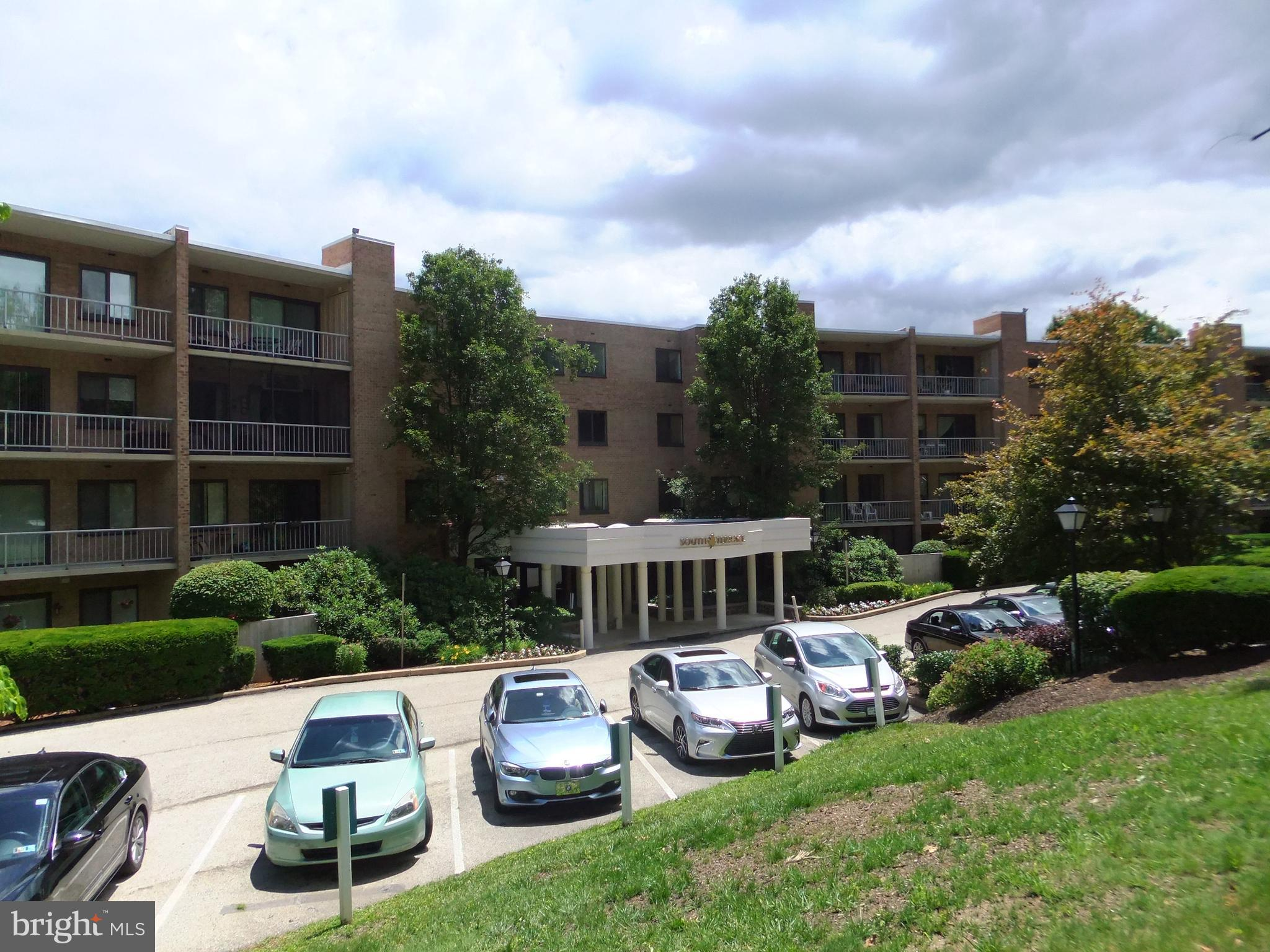"""JUST REDUCED!  AVAILABLE IMMEDIATELY!   Welcome to the South Terrace Building at """"Oak Hill Condominiums"""", Penn Valley, Pa.  This is a rarely available. expanded 1 bedroom 1  1 /2 bath home. This home is on the top (4th)  and just a few steps from the elevator. This home boasts hardwood floor in dining room and wall to wall carpets  and great closet space. There is a coat closet in the stone tiled foyer. The large living and dining areas overlook the large sunny balcony. The home features  designer window treatments and recessed lighting.  Laundry closet with  washer/dryer. Also a utility closet. The home features  a large bedroom suite, bath with shower over tub. and a dressing room area off the bedroom and bath.  Ceiling fan. The dressing room area boasts 2 closets . The home also features  a hall  half bath. Large, Kitchen features lots of cabinets, newer range, dishwasher, pantry, refrigerator, tile floor and more. Condo monthly includes, hot and cold water, sewer, trash and snow removal, exterior maintenance and common area insurance. landscaping and parking. 2 small pets permitted up to 25 pounds, balcony electric grills are permitted. Pool, tennis, pickle ball, basketball, and gym available. Club house facility available for rental. 2 months condo contribution at closing. Great Lower Merion Township Schools, bus at front door. Minutes to center city via Public transportation, #44 bus at front door. xways and nearby train. Convenient to Suburban Square, lots of shopping and restaurants all nearby. Move in ready!"""