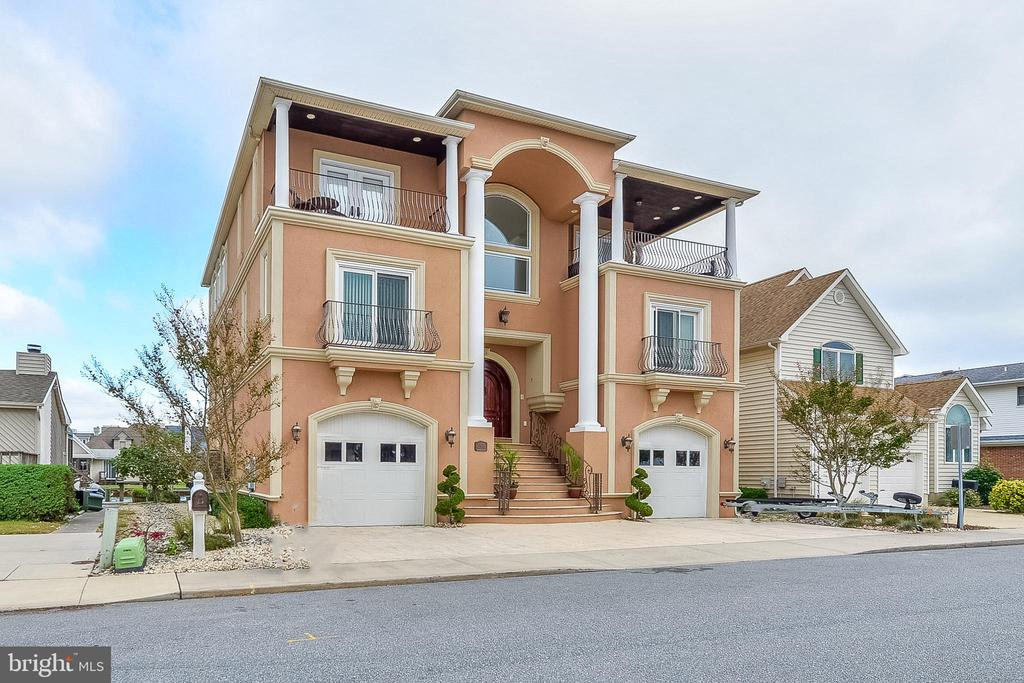 Enjoy luxury shore living in this expansive three-story waterfront home in Ocean City Maryland. Carefully designed to embody the full resort experience, this custom-built home features 6,026 sq. ft. of living space, with spacious floor plans and picturesque views of the bay and the Ocean City skyline. With 6 bedrooms and 5 baths this home is equipped to handle all your potential house guests needs. The elevator adds ease to entertaining family and friends. The boat dock and lift and two jet ski lifts make this home ideal for the boating enthusiast. The added amenities of a fireplace, walk in closets, and a two car garage make this home the epitome of coastal style.