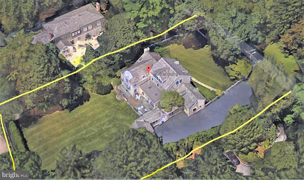 Northside Gladwyne - Fieldstone Manor, 3 Finished Levels provides great spaces for social distancing!! A curved hand-cut BlueStone Walkway leads to the entrance of this 5-Bedroom 8-Bath True-Stone Manor home. Set on a most spectacular flat lot, surveyed for an in-ground pool, lush lawns highlighted by perimeter specimen flowering trees in wonderful maturity. Thoughtfully expanded to create desired family spaces for contemporary and elegant formal entertaining with easy design sense and is move-in ready. Flexible floor plan 5-Bedroom 8-Bath (Two Full Baths in the Owner's Suite) and truly an abundance of closets.  Richly stained hardwood floors welcome at Entry Foyer to elegant Living Room with architectural raised-panel craftsmanship, deep windowsills, the wood-burning White Marble Fireplace offers a focal point on the West wall. Raised-panel craftsmanship continues through Dining Room and adjoins the seated, Butler Pantry with White Carrara Quartz Wet-Bar, Scotsman Fridge, 18-Bottle Stainless Steel Compressor Wine Fridge, then flows into the Breakfast area & Chef's Kitchen offers custom Cabinetry, large seated Marble Island, Two whisper-quiet Asko Dishwashers, SubZero, Professional Viking Gas Range, Ovens & Warming Drawer, the soaring ceilings, Skylights and wide windows bathe the open spaces in natural light. Family Room offers a Stone Fireplace, Floor-to-Ceiling Mahogany built-ins, expansive built-in Desk, Glass Display Cabinetry, Hammered Copper Sink Wet Bar. Southeastern facing windows & triple French Doors showcase genteel Back Lawn views & access the BlueStone Terrace. There is a 1st Floor In-Law Suite with Wall-to-Wall Closets, Full Kohler Bath, Walk-in Shower & Granite Vanity.  2nd floor is an open space with custom cabinetry; built-in desk provides an Office/Study or cozy gathering space. The Owner's Suite has vaulted ceilings with relaxed Cove lighting, a Coffee Bar & French doors open to Romeo & Juliette balcony overlooking the tranquil back lawns, it is replete with His & Her luxury Baths, a Stroll-In Closet, custom fitted built-ins, plus 4 additional closets for Scarfs, Handbags, Shoes. Two additional Bedrooms, Two Full Baths, several Linen Closets & Upstairs Laundry offer deluxe accommodations for both family and guests, complete the 2nd floor. Exceptional expanded 3rd floor has 5th Bedroom; vaulted ceilings, Full Bath, large walk-in Glass Shower, 2 Walk-in Closets, wall of Northern exposure deep seated windows that overlook the lush lawns. Finished Walk-out Lower Level over 1,800SqFt has Gym, Media Room, 2nd Laundry & Full Kohler Bath. Special features are the 1st floor In-law Suite, Full Baths on every floor, double-wide driveway, 4-zone HVAC, open-concept floor plan, gracious expanded soaring spaces, large room sizes, walk-in closets, beautiful lawns, Gas utilities, serene flat Back Lawn, Gardens & Potting Shed with built-in shelving, large sink & Integrated Lawn Sprinkler System, Security System & much more. Walk to the open preserve 30-acre Bridlewild Horse riding/walking trails created in 1927 by the riders of the Gladwyne Hunt, village of Gladwyne, Coffee Shop, Tennis Courts, Beauty Salon, Dining, Parks, 9 miles to Center City. Established neighborhood, ideally located. 7,200+ Sqft provides great social distancing!!