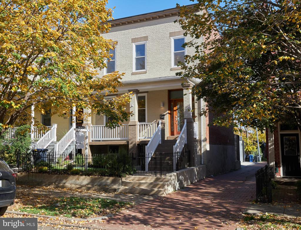 FIRST OPEN SUNDAY 11/15 1-4 The best of everything!  All the charm of this 1909 END UNIT row house, completely renovated in 2015.  Don't miss the brick wall in the main staircase.  Open floor plan features big windows and natural light throughout.   2010 renovation from the mahogany front door to new kitchen and baths, hardwood floors, HVAC, plumbing, electrical, drywall, windows and roof.  Recessed lighting, ceiling fans, freshly painted and new carpeting.  Ready for you to just move in.