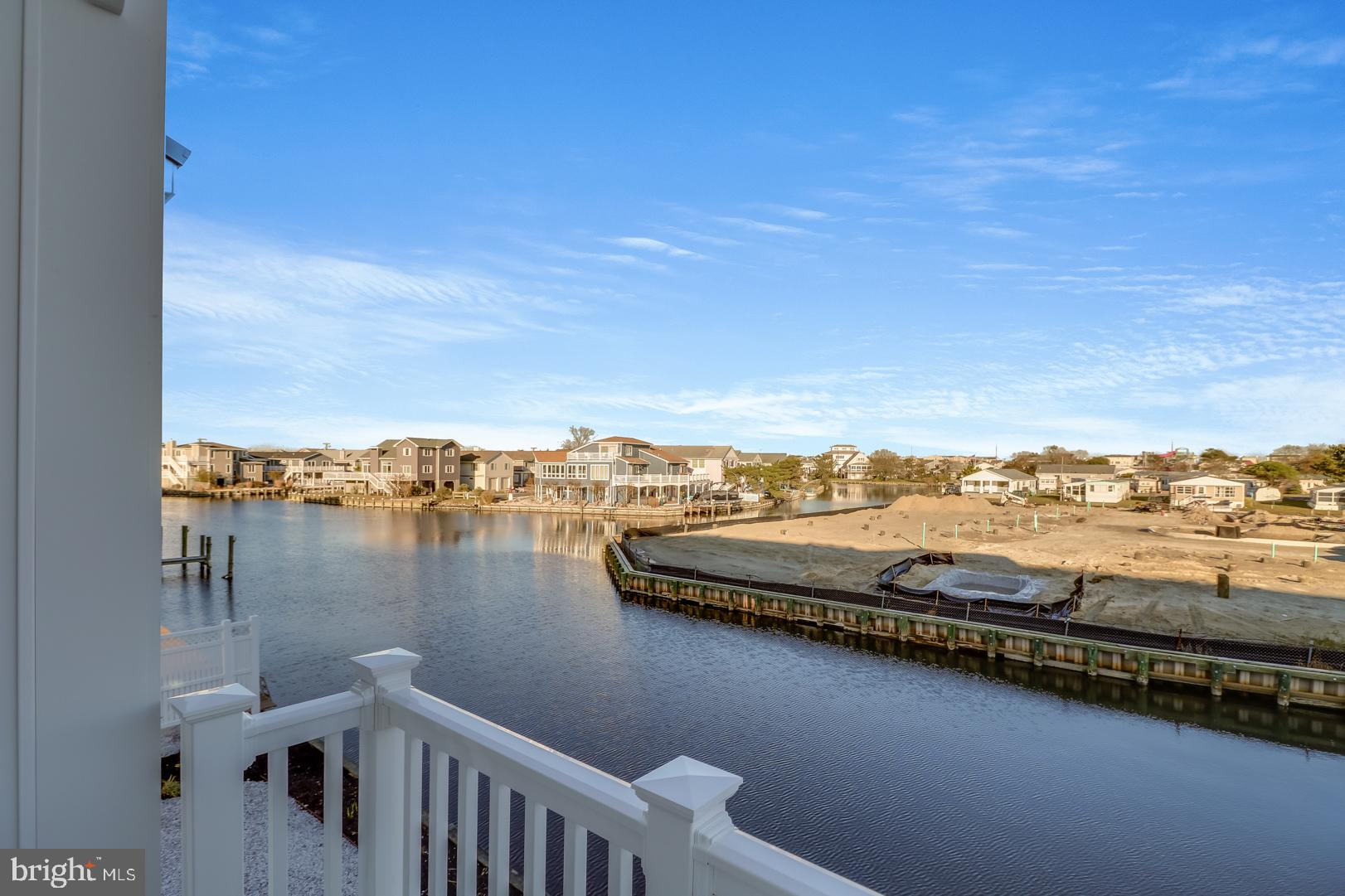 Welcome to Lighthouse View!  Six waterfront luxury townhomes  just a half mile to the ocean in Fenwick Island!  Featuring luxury vinyl plank flooring, quartz counters, KitchenAid and Whirlpool stainless appliances, tile showers, and more luxury upgrades included  standard!  Walk to area restaurants, attractions, and the beach.  Floor plans feature large kitchen, great room, four bedrooms, and three and a half bathrooms.  Rooftop deck to enjoy waterviews of the Fenwick Canals, Lighthouse Cove,  and Little Assawoman Bay!  Five townhomes remain ranging from $659,900 to $729.900.  Unit 1  is an end unit and features a two car garage, gray kitchen cabinetry with white tile backsplash, and white island with quartz counters.  Start living Fenwick Beach Life Today!