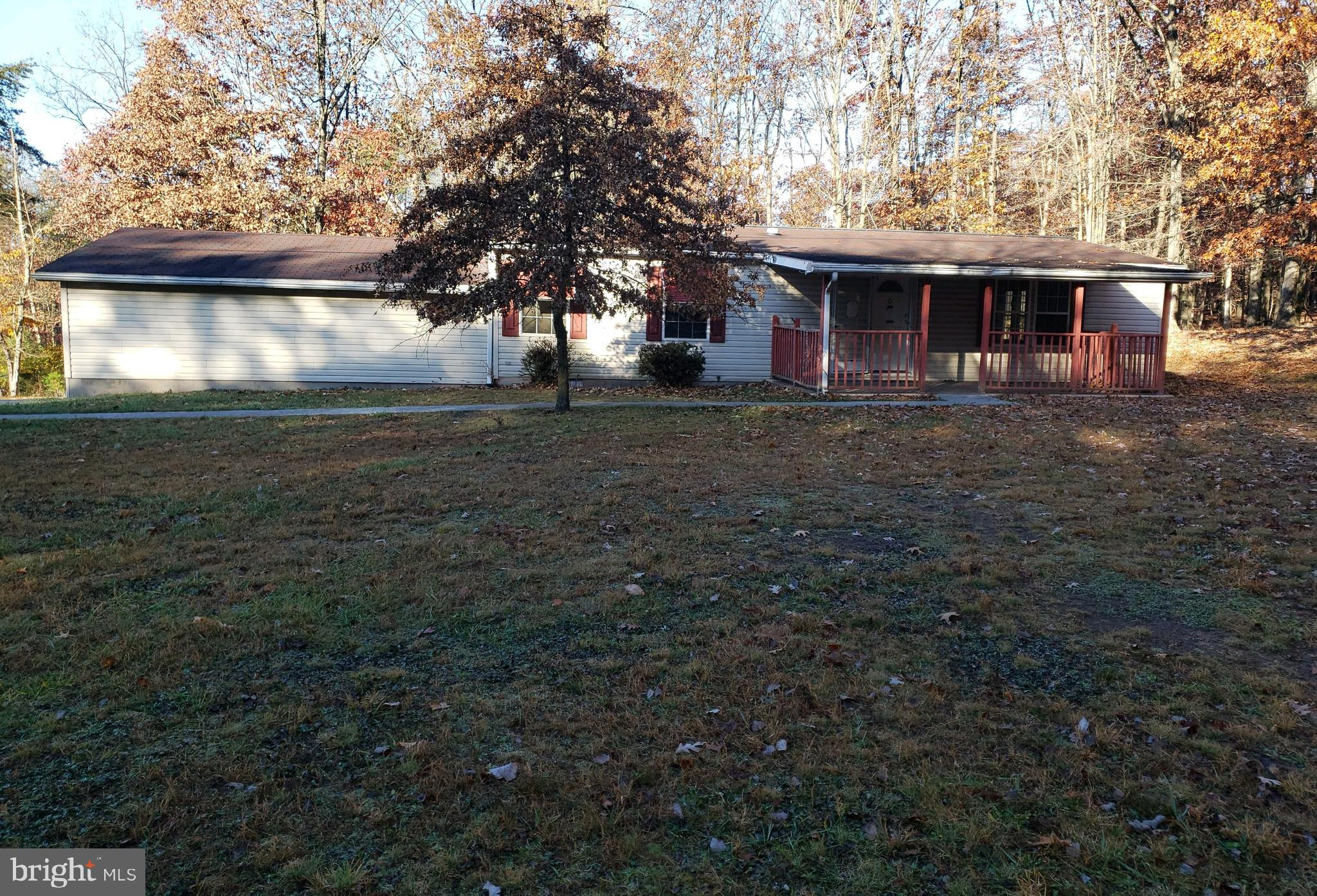 Ranch style home sits on approx. 1.07ac +/- in Berkeley Springs. Home features 3 BRs, 1 FB, covered front porch and attached 2 car garage.