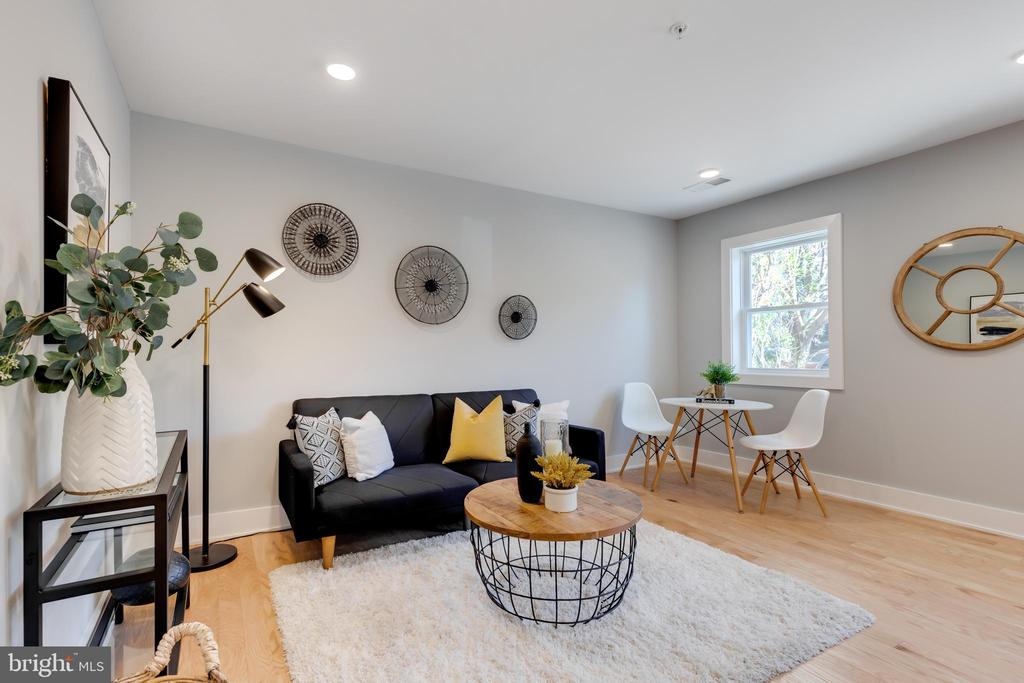 ***$2000 WHEN USING PREFERRED TITLE COMPANY & LENDER*** ***UPGRADE TRIM PACKAGES AVAILABLE TO INCLUDE, WALL ACCENT MOLDINGS, ACCENT COLOR WALLS, SHIPLAP - INQUIRE WITH AGENT FOR FURTHER DETAILS*** 5 UNITS REMAINING -- H Street's newest boutique condo building by 202 Development! 714 Eleventh Condominium provides (12) thoughtfully designed one and two bedroom units with four different floor plan options. Unit 101 exudes a luminous open concept kitchen with white shaker cabinetry, quartz surfaces, crisp subway tile backsplashes and stainless steel appliances. White oak flooring is found throughout alongside striking chrome hardware and fixtures. The bathroom includes a large vanity with under counter storage, soaking tub, subway tile surround, and shower niche. Each unit provides modular Elfa closet systems that can be adapted and adjusted to the owner's evolving storage needs. The building has been outfitted with  energy efficient windows, insulation, and extensive soundproofing. The dining, nightlife and shopping amenities of H street are less than one block away and Whole Foods is an eight minute walk from the building. The free DC Streetcar stop is two blocks from the property and provides an easy 8 minute ride to the Metro (Red) and Amtrak trains at Union Station.