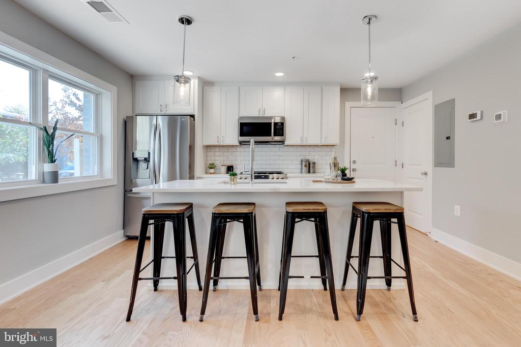 ***$2000 WHEN USING PREFERRED TITLE COMPANY & LENDER*** ***UPGRADE TRIM PACKAGES AVAILABLE TO INCLUDE, WALL ACCENT MOLDINGS, ACCENT COLOR WALLS, SHIPLAP - INQUIRE WITH AGENT FOR FURTHER DETAILS*** 5 UNITS REMAINING -- H Street's newest boutique condo building by 202 Development! 714 Eleventh Condominium provides (12) thoughtfully designed one and two bedroom units with four different floor plan options. Unit 301 exudes a luminous open concept kitchen with white shaker cabinetry, quartz surfaces, crisp subway tile backsplashes and stainless steel appliances. White oak flooring is found throughout alongside striking chrome hardware and fixtures. The bathroom includes a large vanity with under counter storage, soaking tub, subway tile surround, and shower niche. Each unit provides modular Elfa closet systems that can be adapted and adjusted to the owner's evolving storage needs. The building has been outfitted with  energy efficient windows, insulation, and extensive soundproofing. The dining, nightlife and shopping amenities of H street are less than one block away and Whole Foods is an eight minute walk from the building. The free DC Streetcar stop is two blocks from the property and provides an easy 8 minute ride to the Metro (Red) and Amtrak trains at Union Station.