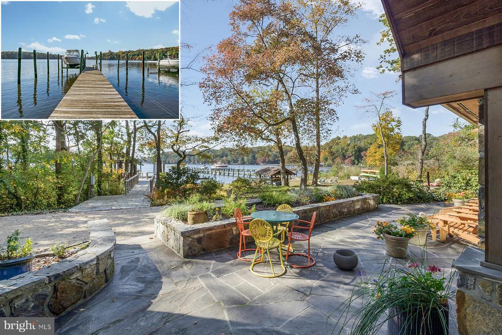 521 Scrimshaw Lane is an elegant waterfront lodge on the Severn River with unfettered natural beauty and a deep-water private pier. Rugged stone, mammoth wood columns, and sweeping walls of glass form an inviting structure that reflects the craftsmanship of the original 1920's dwelling as well as the timeless additions and improvements. The open floor plan is functional, allowing flexibility in the use of space, while also accentuating the water views, privacy, and outdoor areas. Step inside the double mahogany doors to the spacious foyer; the great room to the left blossoms in a mixture of wood finishes, antique brick and, of course, the wall of windows. There is ample seating, whether for dining or relaxing, overlooking the water. The gourmet kitchen includes a large center island with butcher block counter and a Wolf 6-burner range. There is also a c. 1890 Fortress Crawford coal-fired stove that is fully operational in addition to being a great conversation piece! The raised hearth gas fireplace offers a cozy respite on a chilly evening. The main level includes a rec room with bookshelves and an adjoining playroom or exercise room. There's also a bedroom with adjoining full bathroom, and powder room. Outside, the expansive water view patio looks like it belongs in Architectural Digest.  Upstairs, there are three distinct spaces, all with water views: the public ?loft? area that includes room for lounging, an office, or an artist's studio divides the 2nd floor between the primary bedroom suite and the other bedrooms and bathrooms. The luxe primary suite includes a large bedroom, with gas fireplace, that has floor-to-ceiling waterside windows and access to the waterside balcony. The spa-like bathroom has a jetted tub, separate shower, and pretty vanity. There are two walk-in closets. For a short commute to work, there is a library with cabinets and bookshelves next to the bedroom. On the other side of the loft, there is a 2nd bedroom with water views and a hall bath with jetted tub. The 3rd upstairs bedroom suite includes a sitting area with fireplace and waterside bedroom or flip the uses to have a bedroom next to the fireplace and a yoga studio overlooking the river. This bedroom is next to the 3rd upstairs bathroom, with oversized shower. The dedicated laundry room is also on this floor.  The stone and cedar shingle home is the perfect blend of old and new, exuding character and romance. Sited on almost an acre lot with picturesque sunset views, the property includes a sandy beach and a climate-controlled gazebo that sits right at the waters edge. The pier has a boat lift as well as a floating dock, and there is a kayak storage rack. Located in Severna Park, a blue-ribbon school district, this home is just minutes to local shops, dining, restaurants, and major commute routes.
