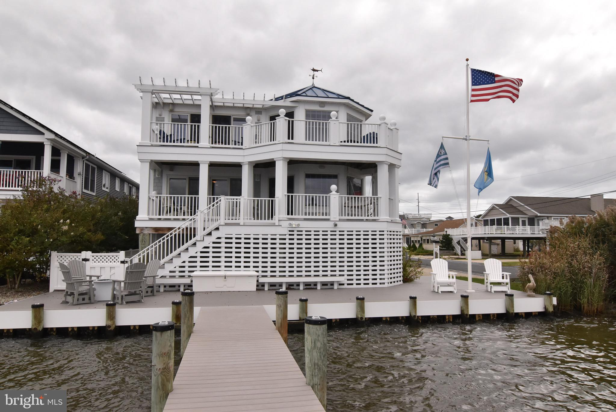 What an opportunity to purchase a custom home completely maintained and updated for 2020 with a private dock and a short skip to the wide, private beach of Fenwick! The beaches here are some of the best! This home has it all, a magnificent master suite on the bay side with views that go on and on! Many private spaces for family and guests,  guest wings on two levels. Each side has large luxurious baths with two sinks and all updated with granite! Off the main level is an enormous  deck area , ideal for entertaining with loads of privacy! The top level of the home  has an enormous gourmet kitchen with Blue Bahia Granite that is striking; a large island , beverage center, gas cooking...floor to ceiling tile fireplace...soaring views of the bay that go on and on...The dining area has expansive views of the water, leading out to the deck . Your dinner guests may never want to leave because it is a smashing spot to dine. Southern exposure/solar panels owned. Home automation system.  In addition there is a sunroom off the top area leading out to a spiral staircase with a roof top deck; ideal for  star gazing, firework displays or simply sunbathing! This particular locations not only has the daytime fun of the bay and the beach but one can also pop into wonderful restaurants, farm markets and local shops without getting into your car.  Walk, Play and Enjoy the Quiet Resort of Fenwick Island