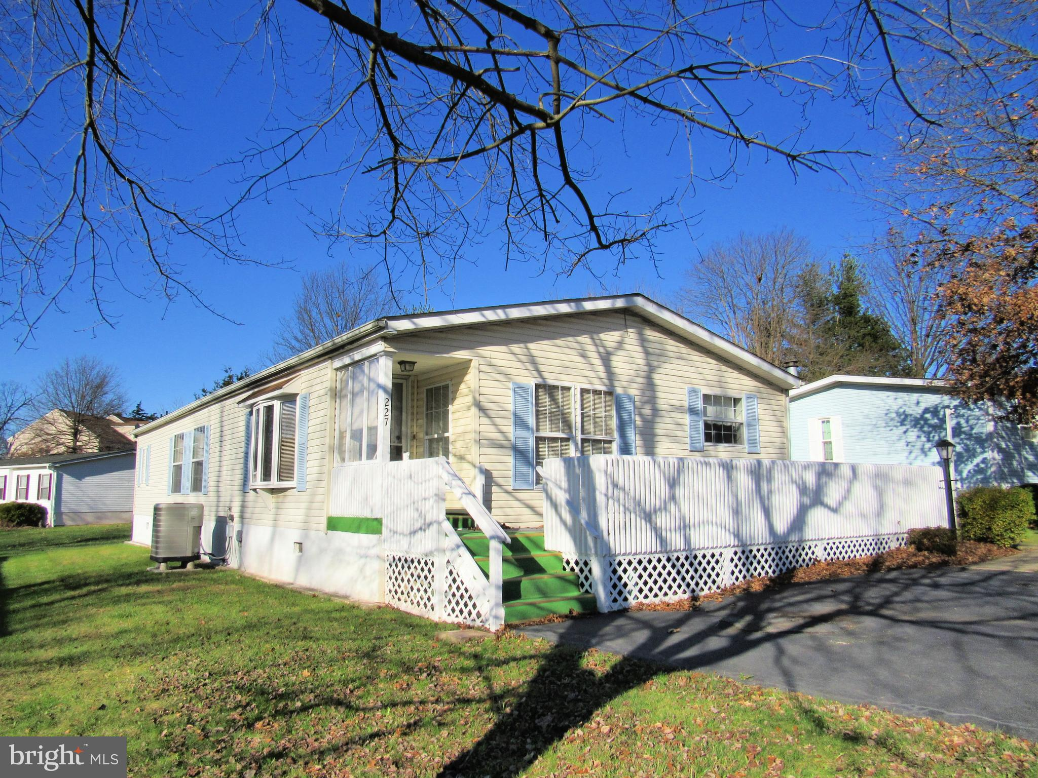 Spacious Red Hill Estates home offers living room, dining room, kitchen,  2 bedrooms and master suite with large bath and walk-in closet.  There is a large laundry room with additional storage.  You'll enjoy sitting on the large front deck or in the side sun porch. Property is convenient to shopping, major routes of travel and Montgomery County Park system.  Current lot rent is $557/month whihc is subject to change.