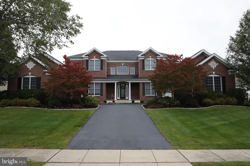 Welcome to this beautiful colonial home, built in the desirable Byers Station neighborhood of Chester Springs.  This magnificent home, which is the largest in the neighborhood, has 6 bedrooms, 4.5 bathes, a giant finished basement, plus a cement pool.  Upon entering this 2 story house, you are greeted by an expansive foyer, complete with chandelier and twin staircases.   The open floor plan features a gourmet kitchen, sunroom, formal dining room, living room, family room and office.  The expanded kitchen is adorned by custom cherrywood cabinets, oversized island and state of the art appliances fit for a professional chef.  French doors lead from the kitchen to a deck, which is perfect for an outdoor grill and deck furniture.  The oversized windows on the 1st floor allow for natural lighting and views of both the pool and immaculate landscaping.  There is a gas fireplace in the family room, perfect for cold winter nights.  The 2nd floor features a stately master bedroom, with 2 large walk in closets,  gas fireplace , 2 separate sinks, private enclosed powder room, large walk-in shower, and Jacuzzi tub. The 2nd floor contain an additional 3bedrooms and 2 full bathrooms.  The large-scale finished basement includes a bedroom, full bathroom, home theatre, large storage room, and a walkout staircase to the pool area.  The pool area is fitted with an EP Henry stone patio and deck, offering the ideal setting for warm weather entertaining. The pool and hot tub are concrete.  The professionally landscaped property includes a sprinkler system and outdoor lighting.  The home resides in the award -winning Downingtown and Stem Academy school district, and is conveniently located near shopping, the Exton SEPTA Station, the PA,. Turnpike, and both U.S. 30 and 202.