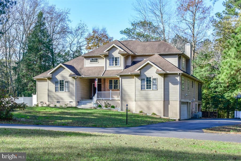 MAJOR PRICE REDUCTION! MOTIVATED SELLERS!  ALL REASONABLE OFFERS CONSIDERED! The Perfect Home For Your Large or Extended Family!  RARE FIND!  OVER SIZED FIRST FLOOR IN-LAW-SUITE WITH FULL KITCHEN, LIVING ROOM & BEDROOM W/ WALK IN CLOSET!  Situated On 2 PRIVATE WOODED LOTS, Almost 2 ACRES IN PINEY ISLAND!  Additional Lot Allows The Extra Room To Build A Private In-Ground Pool w/Bath House  Or Extra Guest Quarters.  Spacious Living & Dining Room Can Accommodate Family & Friends On The Holiday's.  Home Boasts 2 Full Size Kitchens, 5 Bedrooms (First Floor Master Bedroom) Office, Extra Large Bonus Room w/ Separate Entrance, Oversized 2 Car Garage & 2 Family Rooms. Main Level Kitchen Is Off Of The Family Room & Dinette So Your Never Cooking Alone! Family & Friends Can Enjoy The Warmth Off The Wood Burning Brick Fireplace While You Cook Or Can Sit On The Outdoor Deck Or Screened In Porch Off The Family Room.  Master Bedroom Suite Has Walk In Closet, Tiled Separate Shower & Jacuzzi Soaking Tub. Downstairs Is Fully Tiled And A Full Walk Out From Every Door, Has 2nd Full Size Kitchen, Family Room, Full Bath & Bedroom. All  NEW SEPTIC SYSTEM In 2020, Owned Water Conditioning System For Well & 4 Zones For Heat & Air Conditioning So There's Never Any Issues With Comfort.  One Year Home Warranty to Buyers w/Acceptable Offer.   Easy To Show!
