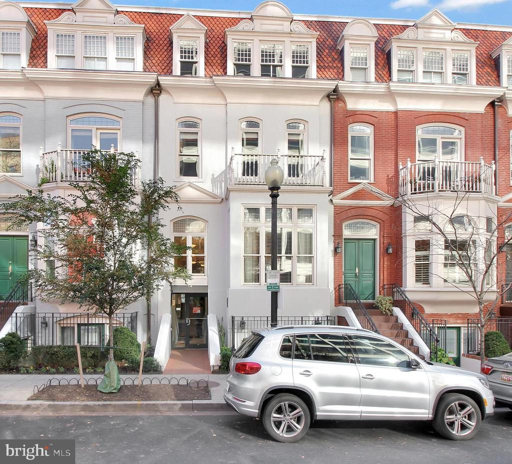 Boutique building in one of DC's best neighborhoods. Corner penthouse spacious 2 bed / 2 bath unit with over 1,150 sf of living space with bonus 200sf rooftop terrace (great outdoor space) and 1 underground parking space.  Beautiful kitchen with granite counters, cherry cabinets, Viking appliances, gas cooking with eat-in style with seating for four. Hardwood floors throughout.  Nicely apportioned bedrooms. Bathrooms with granite vanities. Dual vanity in main bathroom and with frameless glass shower enclosure. Custom roller shades, 2 Walk-in Closets, and in unit washer and dryer. Building includes Gym/Weight room, secure building access. Near two metro lines within 2 DC blocks and restaurants within walking distance. Do not miss out on this gem. Make it your new home today!