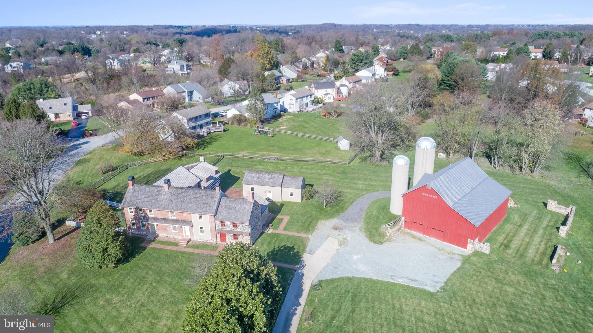 Visit this home virtually: https://my.matterport.com/show/?m=xjujJi7jbZh - Welcome to Penn Manor - this Colonial Center Hall Historical home is located in the heart of Corner Ketch. The land was purchased by the first owner in 1714 from William Penn's son. Mr. Worsley then built one of the first brick homes in New Castle County on the land in 1725. The present owner is only the 3rd family to own this 295 year old historic property. Penn Manor is steeped in local history. The home was restored in 2016 with perfection, impeccable craftsmanship and an amazing addition to compliment the period of the original home. Entering into the home from the addition it is evident that every detail was thought of to tie the old with the new. The game room offers reclaimed floors, and ship lap ceiling with beams emulates an open feeling of a renovated barn. Entering the Sun Porch next it is detailed with beautifully laid brick, replica tin chandeliers, pitched roof line, bright windows and exposed brick from the original part of the home. The Farm Kitchen is outfitted with custom cabinetry by Steve Wagner with warm colors, reproduction hardware, soap stone counters & a butcher block center island. Luxury appliances will exceed the expectations of even the most ardent of home chefs. A bright Breakfast Room is located off to the side of the Kitchen with space for a large farm table. The Kitchen transitions into the Family Room that is a Log Cabin that was transferred to the property from Pennsylvania. The stone fireplace was built with existing stones located on the property. The first floor addition offers a sizeable Mud Room and adjacent Laundry Room. The back stair case leads you to the second story addition. The Owners Suite is complete with reclaimed hardwood floors, an exposed wall of brick, well appointed full bath & walk in closet. The additional two bedrooms in the new section have dormer ceilings, walk in closets and full bathrooms with designer finishes. Walk down the hallway to the brick and stone wall and enter into the original home. There you will find an original Owners Suite with a charming fire place and adjacent full bathroom with a jetted tub. Down the hallway are two additional bedrooms that share a Jack n Jill full bathroom. The front stairs lead you to the original Foyer flanked on one side by the formal Dining Room complete with wainscotting, fireplace, full windows with deep window sills. The other side presents the original Living Room, well sized with fireplace, original windows & hardwood floors. The Library is adjacent to the Living Room and offers built ins & a fireplace. The two story Great Room exudes charm from the Colonial era. There was a ceiling that was removed to create the two story feature. The stone fireplace was rebuilt with stones from the property and the stone hearth & bread oven were restored. The character in this room speaks from the masonry & stone exposed walls. The inviting Guest Cottage offers a versatile space with a full renovation in 2016 from an existing structure to create a living space with Great Room, complete Kitchen, Loft and Full Bathroom. The ship lap cathedral ceiling with exposed beams are a highlight to the Cottage. The Bank Barn is a historic gem and the anchor to the property ... this also was rebuilt by Amish craftsmen during the 2016 renovation. The Barn has been brought into this century offering heated space in the upper level with a basketball court, a batting cage & volley ball net. The lower Barn provides ample storage along with space to house 6 cars. This is a great home for a large family and extended family!  It is not often that a home of this caliber that is steeped in history becomes available for sale. The cost of the renovations exceeds the list price of this home, the owner spared no expense in restoring Penn Manor - it is the perfect blend of history with the amenities of the modern world.