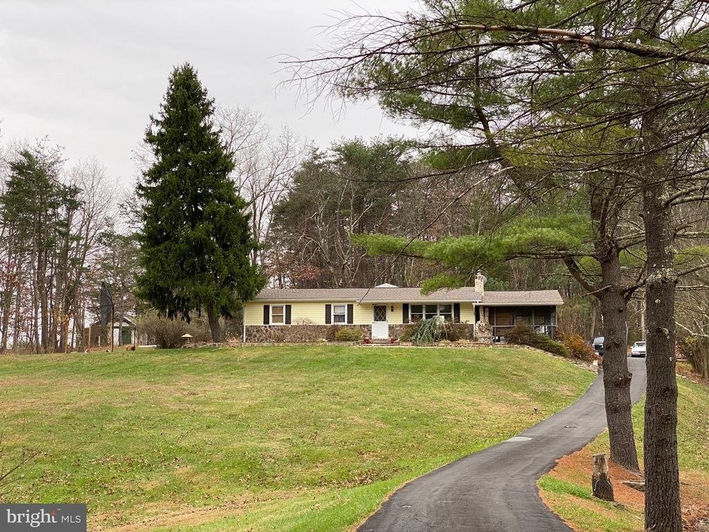 Rancher and Rental - This rancher features:  3 Bedrooms, 2 Baths, Kitchen- Dining Room, Living Room and screened in porch.  Plus an In-law suite behind this house built in 2010.    3.73 unrestricted acres with a pond and paved driveway just 4 miles from town.