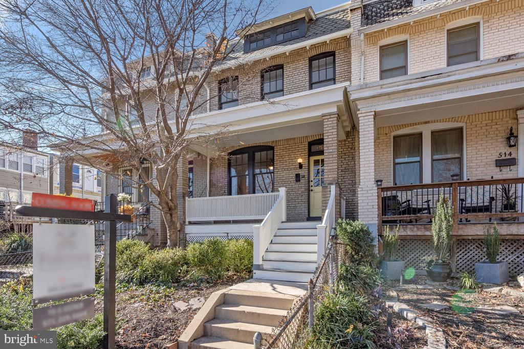 **Price Adjustment** Welcome home to this classic DC Wardman style house which is conveniently situated between Lincoln Park and the H Street corridor.  The curb appeal impresses with an elevated front porch, comfy swing and established front garden including a mature cherry blossom tree. The traditional floor plan spans 1,700 sf with an open feel, great flow, and plentiful sunlight.  The large living room features French doors and gleaming wood floors that proceed into the dining room.  A separate dining room opens to the kitchen, making for a great entertaining home.  White cabinets, granite countertops, stainless steel appliances and partial island at bar height complete the kitchen.  Enjoy the newly rebuilt spacious sunroom off the dining and kitchen with a wall of Pella casement windows.  The sunroom is a versatile space that can be an office, play or family room.  Your upper level boasts three bedrooms, full bath and an additional sun/sitting room. A versatile lower level offers flexible living space with forth bedroom, family/sitting room and full bath.  The  private, low maintenance, rear patio is perfect for grilling, entertaining, and dining al fresco.  Updates include: new roof, new AC condenser, rebuilt chimney, and rebuilt porch with custom crafted front railing and stairs.  Quietly tucked between H St Corridor and Capitol Hill with nearby Stanton and Lincoln Parks, this home shines with historic woodwork and craftsmanship while having all of today's modern conveniences.