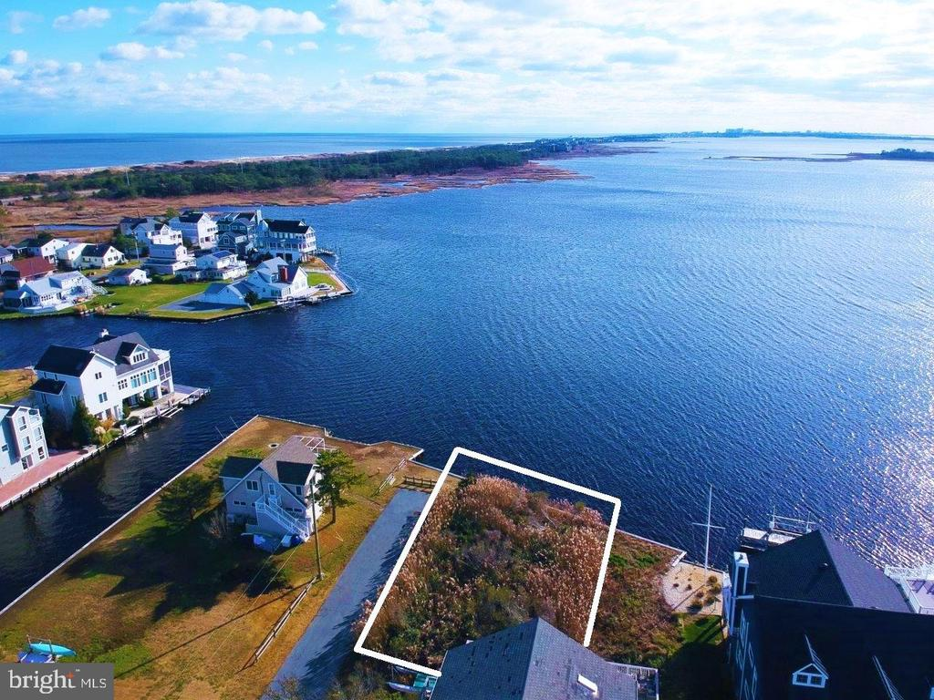 Enjoy incredible panoramic water views from this large bayfront lot within walking distance to the beach! This parcel has nearly 100' feet of bulkheaded waterfront and is situated at the end of a non-thru street in a quiet community just a few miles South of downtown Bethany. Enjoy a day on the beach or take your boat out with effortless access to the wide open bay. This lot features a buildable footprint of approximately 3,950 square feet. A two story home of up to approximately 7,400 square feet and 9' or 10' ceilings is possible with ample opportunities for varied roof levels to allow for increased natural light and dramatic changes in ceiling height.