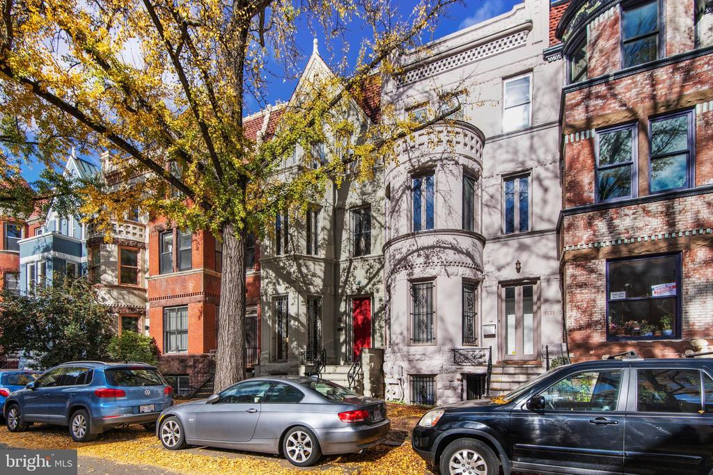 """EXCELLENT VALUE IN THE HEART OF HISTORIC DUPONT CIRCLE. Designed by notable architect T.F. Schneider, this circa 1890""""s home is on one of DuPont Circle's most desirable and quietest blocks. Creative thought has gone into the design of the quality, timeless renovation. From the airy and open concept kitchen and dining room to the traditional floor to ceiling windows, high ceilings, oak flooring throughout, and three beautifully mantled fireplaces, period accents help to define the environment of this beautifully detailed home. A welcoming, bright south-facing foyer welcomes you to the home's living room with wood-burning fireplace. Continue past the main level powder room to a spacious granite kitchen with high end appliances, ample custom cabinetry, and center island - all opening to a very generous dining room with two doors that welcome you to the rear patio and parking access. The second level has a versatile floor plan consisting of a gorgeous, bright great room with fireplace, guest bedroom, open concept den/media room with fireplace, and guest bath. The great room and den are easily usable as bedrooms for a total of three on this level. Ascend to the primary bedroom suite on the third level. Here is a quiet sanctuary with walk-in closets, beautifully renovated bath, full size washer/ dryer, and a spacious roof deck! A large skylight streams abundant light to all three levels of the main house. The lower level is a high income, legal two bedroom apartment complete with certificate of occupancy. The current lease generates $2700.00 per month. OPEN HOUSE Sunday 12/6 by appointment only. Schedule with Martin Toews at 202-255-9195."""