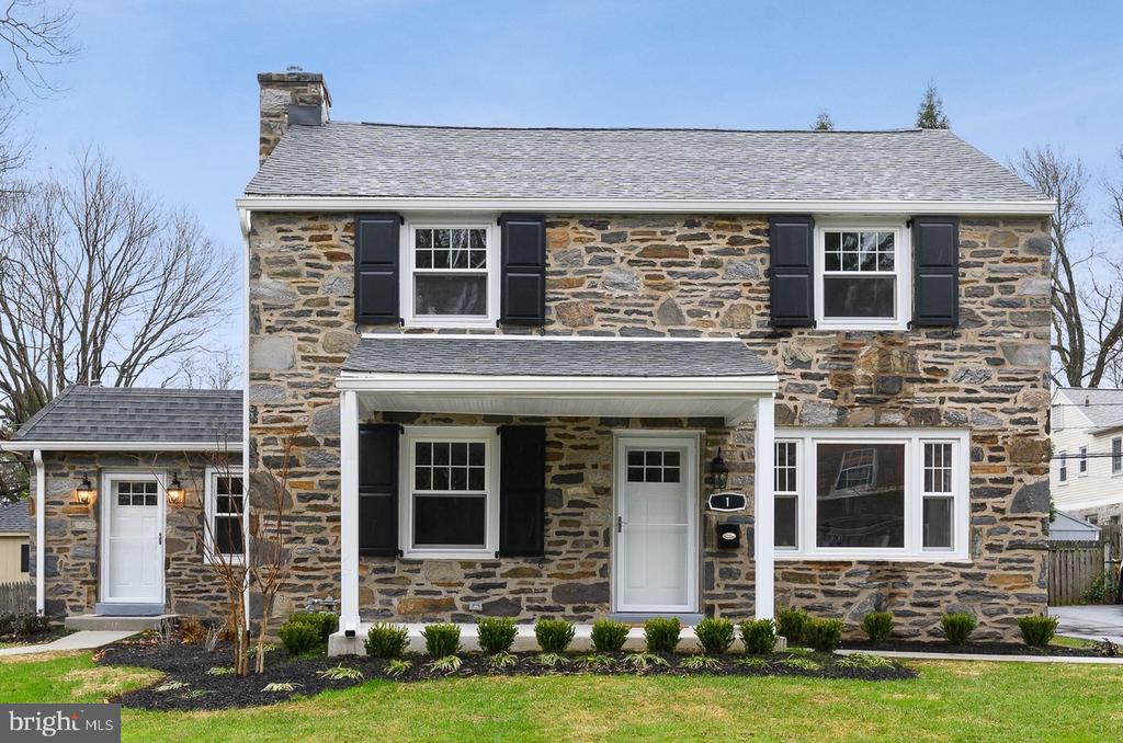 Beautifully renovated 4 bedroom, 2.5 bathroom home with family room addition on a quiet street in top rated Radnor School District.  This home has been completely redesigned offering a formal yet open floor plan desired by today's buyer.  Enter through your open front porch and you are greeted with refinished hardwood flooring and flanked by both formal dining and living rooms.  Both rooms are spacious and offer crown molding and decorative four ft tall wainscoting.  The new kitchen with white shaker cabinetry, stainless steel appliances, and quartz counters opens into the breakfast room with built-in shiplap bench for eating and bar area with shiplap wall, floating ledges, and wine cooler.  The eating area overlooks the large family room with the focus being the floating, flat panel gas fireplace surrounded by wall paper accent wall.   Off of the family room, there is a powder room and mudroom with custom, navy built-in cubbies.  The second level offers an elegant master suite with new marble bathroom with gray dual vanities with quartz tops and stall shower.  This level is completed with three other spacious bedrooms and new tile hall bathroom with white shaker dual vanity with quartz top and shower/tub combo.  The house offers a new roof and gutters, new energy efficient windows, new electric and plumbing systems and fixtures throughout, and so much more.  All of this while being walkable to Villanova University and all the great shops and dining of Bryn Mawr.  Call today for more information!