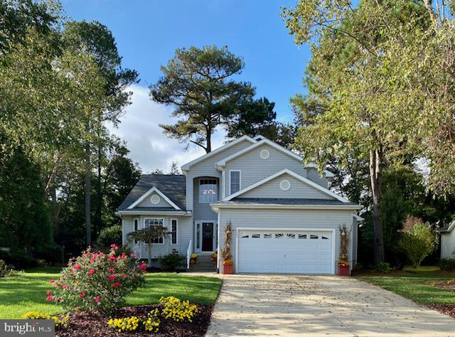 This beautifully upgraded home is located in the prestigious community of Ocean Reef. Desirable location, minutes from Ocean City, West OC, Berlin, and beautiful Assateague Island Seashore. It is situated on a pretty wooded lot, on a quiet street, across from the pond, in a well-kept development, with optional pool membership. Membership Fee $285.00 per year. Enter through the pretty two-story open foyer to a beautiful formal living room and large dining area. High-end cherry hardwood floors enhance this space. The gorgeous dressy kitchen boast granite counters and upscale Cabico kitchen cabinetry lend itself to the beautiful look of fine furniture: pantry cabinet, cutlery draw, and many extras. The breakfast room has a fabulous matching wet bar that enhances the area for entertaining.   Overlooking is a cozy gathering room with a fireplace that offers views of the wooded yard and oversized deck.  While we were visiting, deer, rabbits, and squirrels were visiting too.   This home has three large bedrooms. The master's first-floor on-suite has His and Her walk-in closets. A fabulous bath with an oversized soaking tub, custom steam shower with jets, water closet with pocket door, custom vanities, and gorgeous marble floor. Upstairs are two good-sized bedrooms with large closets. A full-size bath with a beautiful onyx marble floor has entry through one bedroom and the hall. A bonus is a spacious loft area for a home office or a sitting room. This home with large addition, high ceilings, and many upgrades throughout is ready for showing. Inviting warm and cozy sums it up.  To see it is to love it. Call listing agents Denise Milko mobile 410-430-7188 or Leah LeCates mobile 410-726-4901.