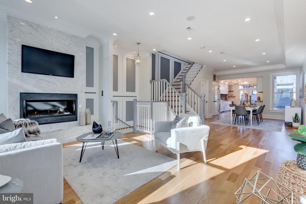 "Price improvement and open Sunday, 12-2pm! Looking for a home thats worthy of your loftiest real estate resolutions? Welcome to 648 F Street NE, a classic Capitol Hill escape where historical charm meets contemporary style. Built in 1911 and set across approximately 2,900 square feet, this 6-bed, 4.5-bath single-family home has been reimagined to stand the test of time, without compromising on character. Outside, the gorgeous flagstone entry sets the tone for what you'll find within: a home thats designed to impress even the most discerning of buyers. Step through the front doors to be greeted by an open, inviting floor plan thats punctuated by stunning oak floors and saturated with south natural light. In the main living area, flexibility reigns, with plenty of space to enjoy all of life's moments- whether you're cozying up by the marble fireplace or toasting with friends. Just beyond the main living area, you'll find the kitchen, a true chef grade oasis with its spacious layout, state-of-the-art appliances (including a 48"" Thermador touch soft open/close fridge and a 36"" six burner Miele gas range), quartz counters, and luxe cabinetry. Modern details have been thoughtfully infused throughout the entire home- from fashionable light fixtures, to crown molding, clever storage, and nautical touches. Upstairs, three spacious, light-filled bedrooms with built-in closets are made for unwinding after a long day, including the owners suite with vaulted ceilings, and another that offers a sweeping deck with iconic city views. Even the bathrooms upstairs evoke tranquility thanks to marble countertops, floors, and tiling. Other coveted conveniences include video security and JBL sound system, as well as a five station intercom. Beyond the amenities found in the main house, though, theres even more to discover. Two floors down, a 2-bed, 1-bath lower-level apartment is your turnkey in-law suite or rental opportunity- based on whatever your needs require. And at a time when you can never have too much well designed space, here, the possibilities are endless. Just off the kitchen, your very own carriage house complete with 1 bath and garage parking - can be effortlessly transformed into a fitness studio, a home office, or an extra living space - to name just a few. Last but certainly not least, the homes french doors open out onto an idyllic outdoor balcony and patio, perfect for getting some fresh air and alfresco entertaining alike. A  Nestled on a picturesque street just moments from the vibrant Capitol Hill, Eastern Market, H Street Corridor, Union Station, and Union Market, 648 F Street NE is an address in demand. Residents here will find themselves at the center of a tight-knit community with all the perks of city living and none of the hassle. Sample the neighborhoods eclectic selection of hip eateries and quirky bars, shop for vintage threads, and explore the many historical landmarks at your fingertips. The cant-miss opportunity of the holiday season, 648 F Street NE."