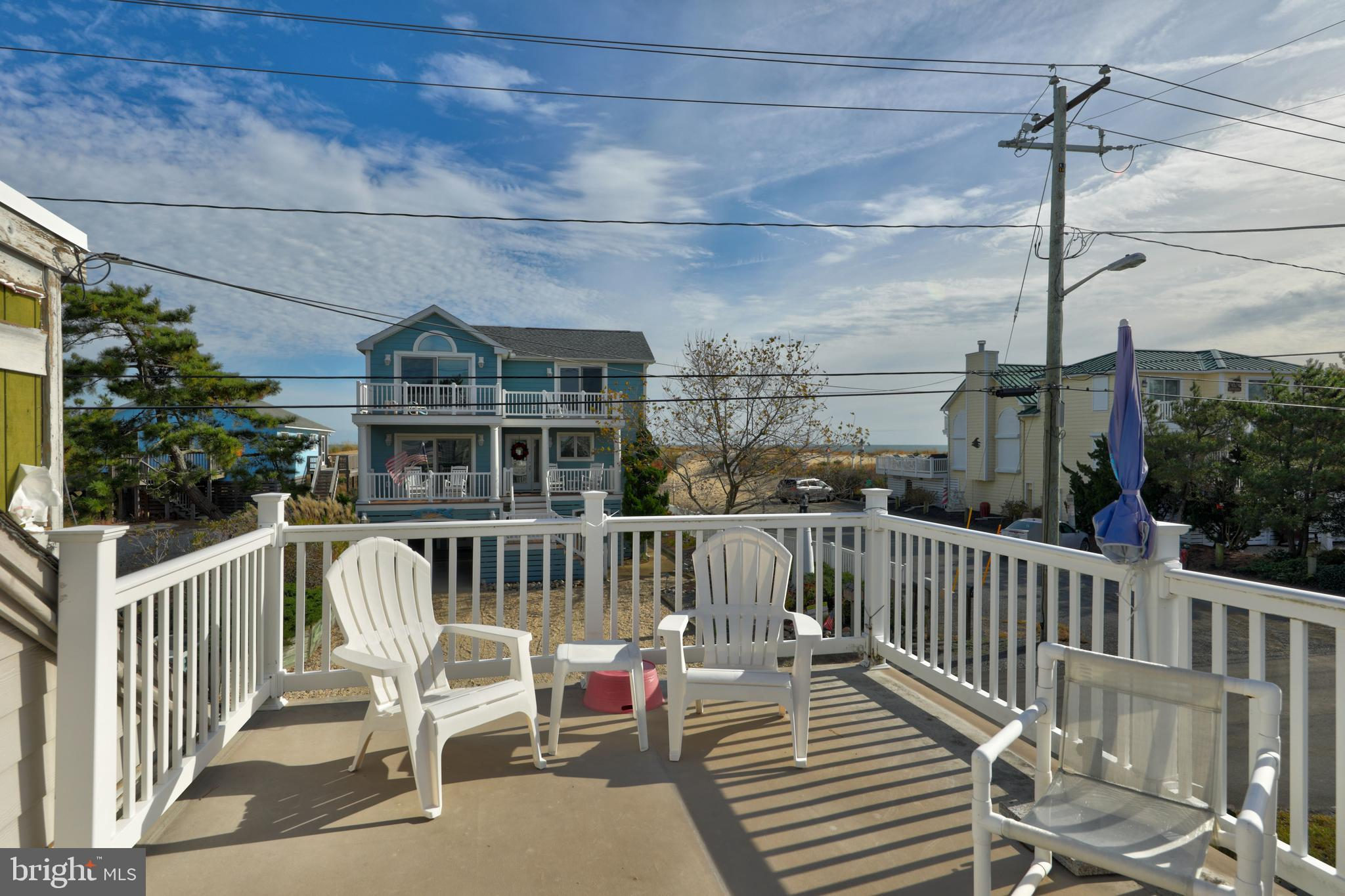 """LOCATION!!  Oceanblock!  Second house from Ocean Beaches in Fenwick Island, and One block south of Fenwick Island State Park!  When it's location you're looking for this is it!  Corner property just waiting for you.  This four bedroom cottage offers a front porch with roof top deck.  A beautiful spacious library for all of your beach reads and more.   First floor offers kitchen, living room, 2 bedrooms, laundry and the wonderful library.  Second floor offers two bedrooms, access to the roof top porch deck, spacious walk in attic storage.   The large spacious garage area offers approx. 480 sq. ft  giving you extra space for  a workshop/storage area and an additional storage/loft area is located over garage.   Great location on the north end of Fenwick Island within town limits.   Home sold """"AS IS""""      Sold Unfurnished   Masks and gloves required for all showings."""