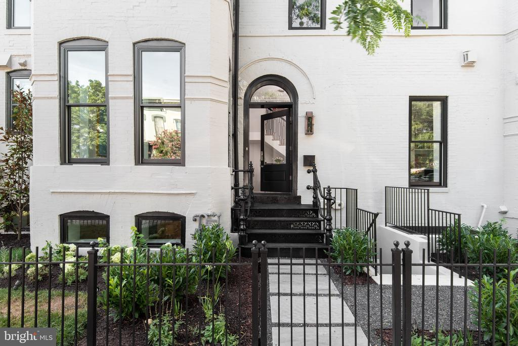 """New Price! We're excited to relaunch this stunning Logan Circle home. The developer spent several weeks carefully redesigning the dining room, and opening up the kitchen to create a wonderful entertaining space for family and friends.  The listing was named """"House of the Week,"""" by The Washington Post. Prepare to be amazed. A luxuriously designed, light-filled magnificent single family residence by Lot Squared Development in DC s Logan Circle Neighborhood. This stunning corner block Victorian sits a short walk to the shops and restaurants of 14th Street and lively entertainment offered along the U Street Corridor. The house design showcases the original 1906 Victorian architecture including large window lined turrets soaking the home in sunlight. The interior of the home has been completely rebuilt and tastefully modernized with living and entertaining in mind. Over 4200 SF, elevator serving all floors, private secured parking, and breathtaking rooftop views."""