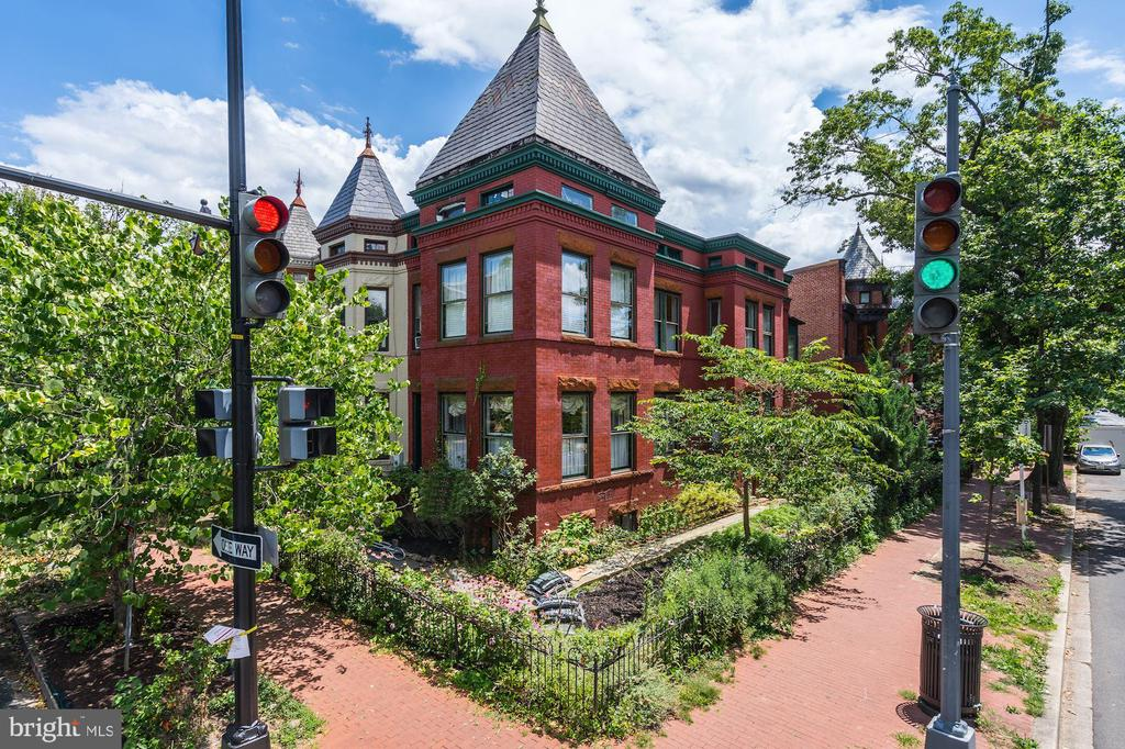 No Showings until Dec. 27th.   Best value on Capitol Hill!  This light-filled home will make you smile. Spectacular 5bd+den/3.5ba Victorian row home - spanning over 3,500 sft - is supremely located in the heart of Eastern Market! Situated on a corner lot, and outfitted with more than 30 windows, this grand home, with its high ceilings and stunning architectural distinctives, is flooded with natural light throughout. Immediately upon entering, it is clear that this house has tremendous depth and character that you simply cannot find in new construction. Tile work in the entryway, crown molding, stained glass door frames and built-in bookcases throughout the home features the trademark craftsmanship of a turn of the century Hill house. This vintage charm is married seamlessly with modern light fixtures, a spacious eat-in kitchen with newly refinished cabinetry & a large island, opening to a lovely side patio, stone walkway, and garden. A bonus room connects the main living area and the dining room - outfitted with multi-use desk space, ample storage and floor to ceiling shelving it is perfectly suited to serve as a home office or homeschooling space invaluable assets during this season. The formal dining room, with built in curio cabinet, is ideal for entertaining and hospitality, comfortably seating 12+ people with easy access to a half-bath. Three large bedrooms, including a sizable Master with custom built-ins and an en suite bathroom, comprise the second floor. A second full bathroom, complete with black and white checkered tile flooring and a claw-footed tub, as well as newly refinished hardwood floors in all of the bedrooms round out the second floor. An apex third floor loft is ideal for fantastical child s play, a home office, or a 4th bedroom, as well as significant attic storage. Finally, the spacious lower level consists of a 2bd/1ba apartment with its own exterior entrance as well as interior connecting stairs. The apartment is separately metered with veri