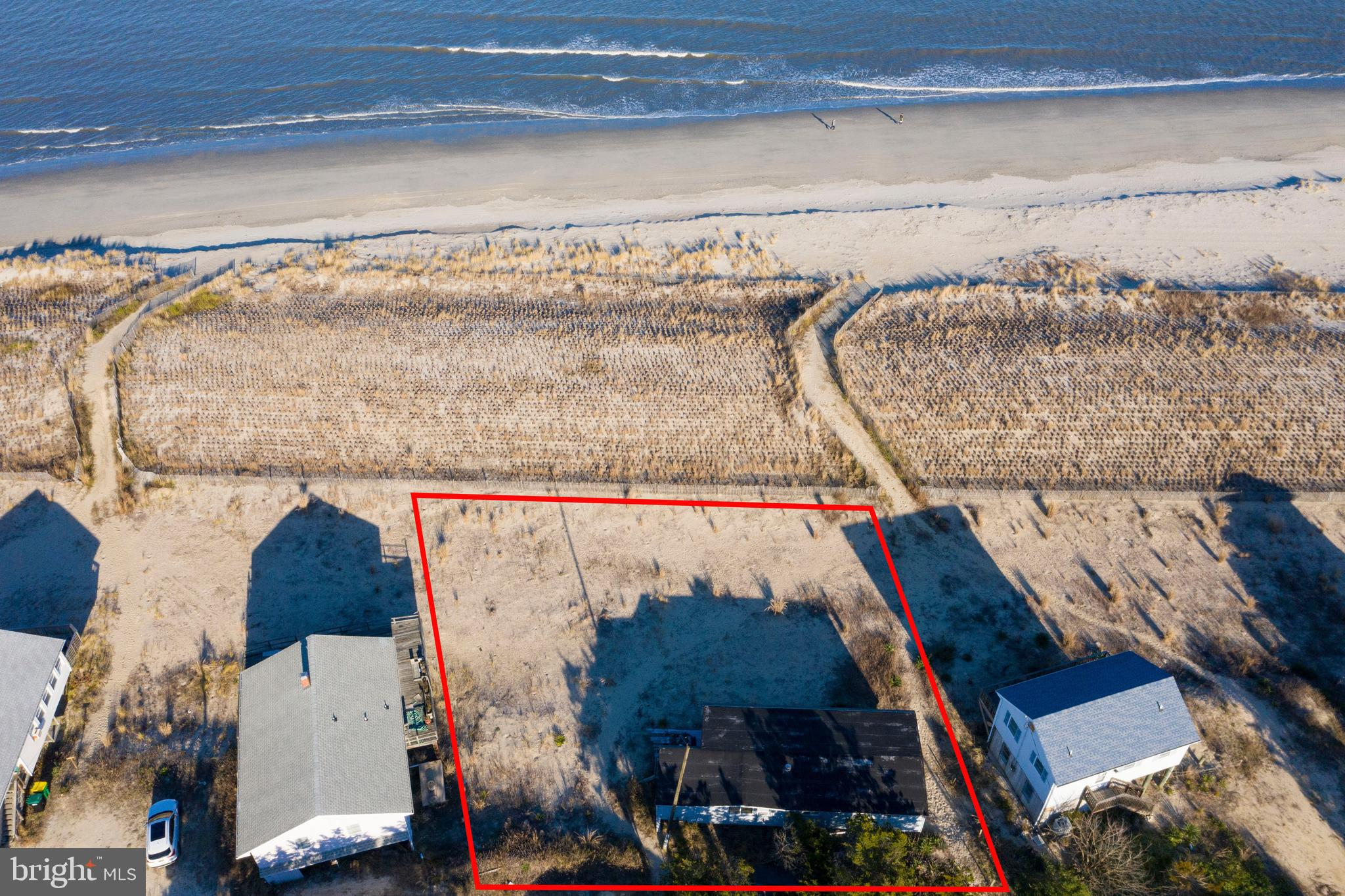 GREAT OPPORTUNITY TO BUILD YOUR WATER FRONT CUSTOM BEACH HOME OR REHAB THE CURRENT STRUCTURE.  Double lot for room to build your dream home you've always wanted. Spectacular views allow you to watch wonderful sunrises, enjoy the waves and dolphin watching and walk off your newly built home and enjoy the sand between your toes and fishing. Broadkill Beach is a quiet spot for you to kick back, relax and enjoy the beach and all the fun activities it has to offer. Conveniently located, this property is close to historic downtown Milton where you can enjoy shopping, dining and grocery shopping away from the crowds.  Also, 20-30 minutes drive to Lewes  and Rehoboth Beaches.  Property is 2 lots combined into 1 parcel and currently has a home on the property that is being sold in as is condition.  Do not enter property as the condition of the inside of the home is unknown.