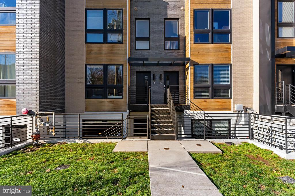 Located within walking distance to everything that Brookland has to offer and the Metro, you will want for nothing! Stroll right across the street and enjoy a leisurely picnic day in Noyes Park.  Don't forget to join the community garden at Noyes Park and put your green thumb to work! This stunning townhome style condo is like new! It's a modern, light-filled home with gorgeous hardwoods throughout the main level and hallway upstairs, custom window fixtures, custom closet organizers, and an open floor plan perfect for entertaining. The modern kitchen boasts a beautiful island, gorgeous cabinetry, quartz countertops, and gas cooking. The entire main level features an open floor plan and a nice patio off of the main entrance. The upper level has a spacious owner's suite with two walk-in closets, a Juliet balcony and an attached owner's suite bath showcasing a beautiful, modern shower with glass doors and a dual vanity. The second bedroom features huge windows and a perfect space for a home office or guest bedroom. The washer and dryer are conveniently located on the bedroom level.  The home also features a private parking space, P12, that conveys with the property.  This condo is also VA approved! Welcome home! Check out the 3D Tour: https://my.matterport.com/show/?m=juitkt6DzZ7&mls=1