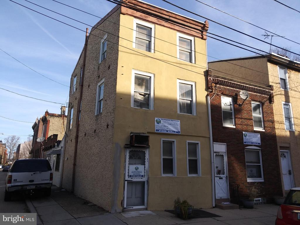 Attention Investors and Developers! Up for sale is 175 and 177 W. Thompson st. Tax ID#182161500 and 182161600 a package deal for 2 houses in Olde Kensington a few blocks from Fishtown! 177 is a 3 story 1,507 sq.ft. 4bd. corner house with a 2 car garage with curb cuts on Palethorpe st. and 175 is a 2 story 936 sq.ft. 3bd. house. Both lots have irregular dimensions totaling approximately 1,904 sq. ft. combined as per public records, see pics. Directly across the street you will find 4 story multi family new construction and something being built or rehabbed on just about every other block.  Being sold AS-IS, both houses are filled with old furniture, clothing and trash and it will be the buyers responsibility to clean out. If interested do you your due diligence and drive by, there isn't much to be seen inside except for trash and old furniture, if you would like to set up a showing proof of funds will be required as per sellers instructions, this includes buyers agents.