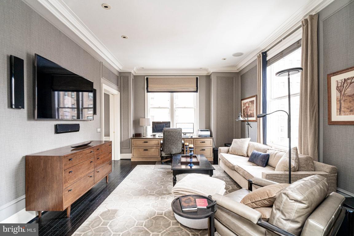 Impeccably renovated and designed two bedroom, three bathroom condominium at The Barclay on Rittenhouse Square. Enter the home through a grand and welcoming marble foyer with decorative wainscoting. The open living room-dining room offers a dramatic column entry, medallion ceiling detail, wall of bookshelves and sunrise views to the east. The chef's eat-in-kitchen features flat panel wood cabinetry, including a large center island with pendant lighting, granite countertops, oversized under-mount sink, stainless steel Viking dishwasher, stainless steel Sub-Zero refrigerator with freezer drawer, a Gaggenau wall oven, Miele cooktop with Gaggenau vent, GE Profile stainless steel wine refrigerator, brushed stainless steel backsplash and glass dining bar with views of Rittenhouse Square. The master suite has custom built-ins, medallion ceiling detail, large windows facing north and west, a window seat, custom fit-out walk-in-closet and designer bathroom appointed in marble with double vanity and seamless glass oversized  shower with exquisite tile detail and built-in seat. A second bedroom (or den) has mirrored French doors that open into the living room; it has a full ensuite bathroom with mosaic tile floor, seamless glass oversized shower with built-in seat and pedestal sink. A third full bathroom has a marble floor, wood vanity with marble countertop and oversized seamless glass stall shower with built-in seat. Additional home features include a side-by-side Bosch washer and dryer, beautiful hardwood floors, 9 foot ceilings, crown and baseboard moldings, custom paint and wallpaper, surround sound and recessed lighting. Residents at The Barclay enjoy the security of a twenty-four hour doorman and on-site management, plus the convenience of concierge service, a chauffeur- driven Mercedes, a fitness center and individually controlled heating and air conditioning. All of this is merely steps from sidewalk cafes and fine dining.