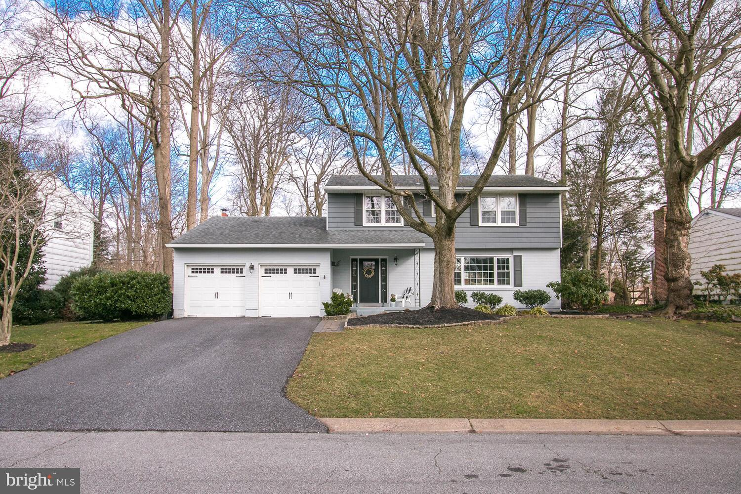 Visit this home virtually: https://tours.propertysnappers.com/public/vtour/display/1762198?idx=1#!/ - Start your New Year off right in this fabulous 2-story colonial located in the always-popular N. Wilmington community of Brandywood. This home boasts a hard-to-find open floor plan including a beautifully designed kitchen renovation featuring stylish white cabinetry, chic Carrara marble counter tops, farmhouse sink, stainless steel appliances, a large center island with seating, sleek black granite counter top & built-in microwave. The adjacent dining area & generously-sized great room makes this the the perfect spot for gatherings! A few other must-haves in this 4BD, 2.5BA home include: gleaming hardwood floors, replacement windows, updated light fixtures, plenty of natural light & a tasteful color palette throughout. The main floor family room is warm & inviting with a wood-burning fireplace. Convenient main level laundry & powder room completes this level. On the second floor you'll find the well-sized primary bedroom with walk-in closet and renovated private updated full bath. Three additional bedrooms share the full hall bath. Wonderful curb appeal plus a level rear yard with large paver patio & mature trees for your natural summer shade. A two-car garage with interior access plus an unfinished basement offering plenty of storage space or an opportunity to finish for additional living space completes the package. 2021 - New Gutters, 2019 - Insulation improvements completed per Energize Delaware's Home Performance with Energy Star Program. Close to convenient shopping & dining in N. Wilmington or nearby PA with easy commutes to Downtown Wilmington or Philadelphia. This home is a great choice that you'll be proud to call HOME.