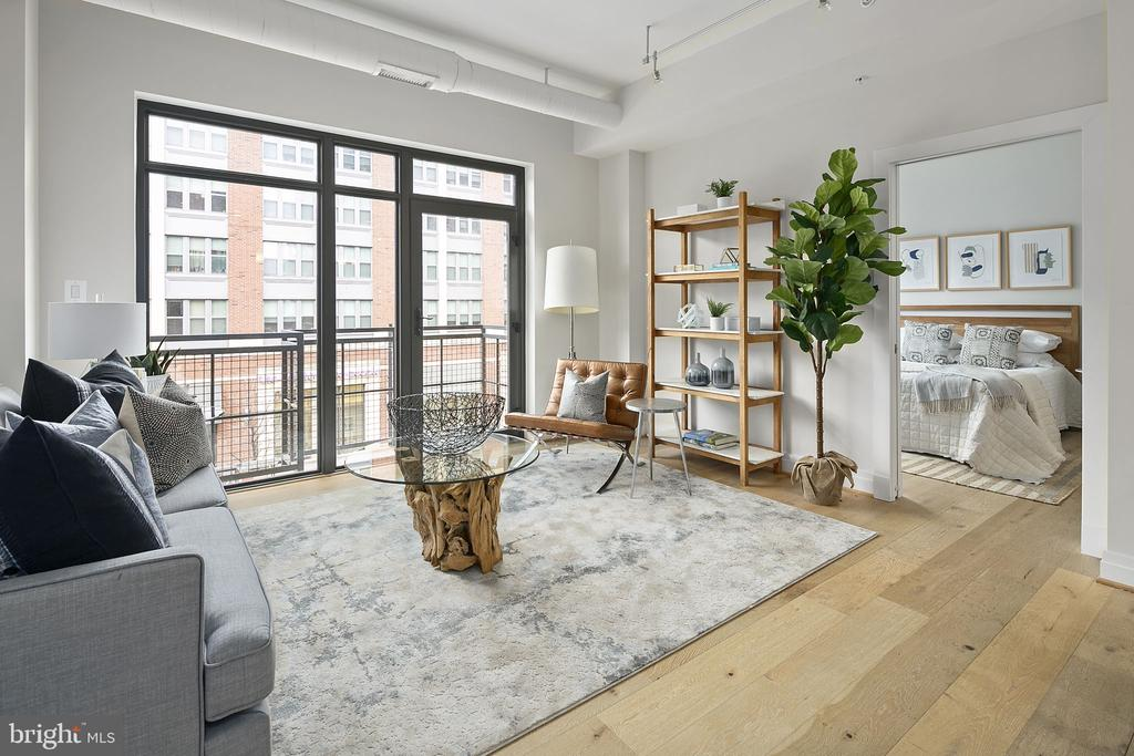 Fantastic 2BR with a coveted assigned parking space! The high ceilings and large floor to ceiling windows in every room create an open and bright space. Located one block from Union Station, this two bedroom/two bathroom features modern, luxury finishes such as quartz counters, hardwood floors, an open floor plan, a private balcony, and W/D in the unit. The thoughtful floor plan wastes no space with large bedrooms, a huge primary bedroom closet, and spacious bathrooms. The kitchen features wide countertops and plenty of space for multiple cooks as well as modern appliances.   301 H Street is a well managed, boutique condominium building with a low fee. Steps to Giant grocery and blocks away from Whole Foods; a short walk to Union Station for transit and shopping; charming local restaurants like Ethiopic and Cane right on H St; easy access to the streetcar to take you up and down H St.; and right above City Dogs for all your pet needs. Property may be available for sale at a reduced price without parking.  Inquire with listing agent