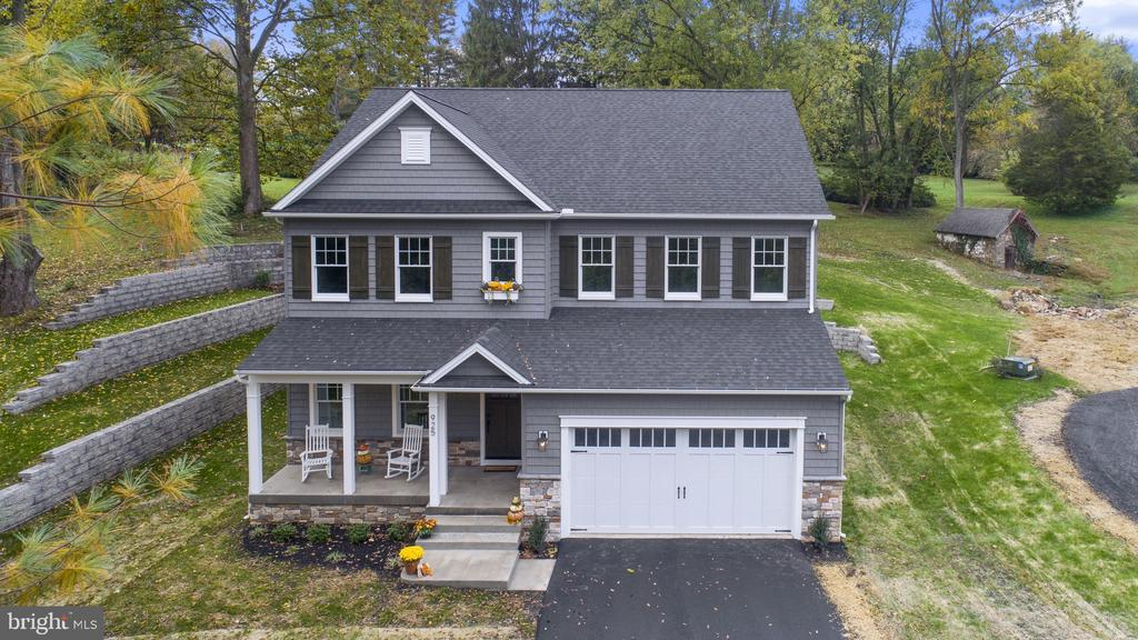 """Visit this home virtually: http://www.vht.com/434113743/IDXS - NEW CONSTRUCTION in the Red Clay School District! Located in the idyllic setting of Bridleshire Farm this home is Ready to Move Right In!! Custom Built by Premier Builders - the quality and craftsmanship in this home are apparent from the street curb appeal! The stacked stone, shingle siding and board & batten shutters make way to the inviting front porch. As you enter the home you are greeted by stunning hickory hardwoods in a rich dark stain. To the left French doors lead to an intimate Living Room that overlooks the front porch. Entering the heart of the home this stunning Kitchen is crisp in contrasting colors of Pewter Wolf Classic 42"""" cabinetry with white Carrara Marro Quartz countertops. Gold accents in hardware and lighting add depth to the room and topped off with a Parisian flair tile backsplash for the back drop to the gas cook top. The quartz island is grand and offers a wonderful gathering space for entertaining. Sleek stainless steel appliances by GE Cafe complete the gourmet kitchen. The eat in Kitchen overlooks the brick paver patio and private setting of the rear landscaped yard. The Great Room features a stacked stone gas fireplace that offers a cozy space to relax or collectively watch a movie! The bonus 5th Bedroom on the first floor has an adjacent full bath. The second story Owners Suite presents double closets and a decorative tray ceiling. The Owners sumptuous Bathroom is stunning with 24"""" x 24"""" white tile floors, expansive double sink vanity complete with an abundance of Pewter Wolf Classic cabinets & drawers. The focal point of the bathroom is the oversized rainfall shower accented with a chic decorative Arabesque tile centerpiece and a custom seamless glass shower door. The second story is also adorned with 9' ceilings and three additional bedrooms that are spacious with large closets. The front Bedroom, in particular, boasts a generously sized room - bright with three windows """
