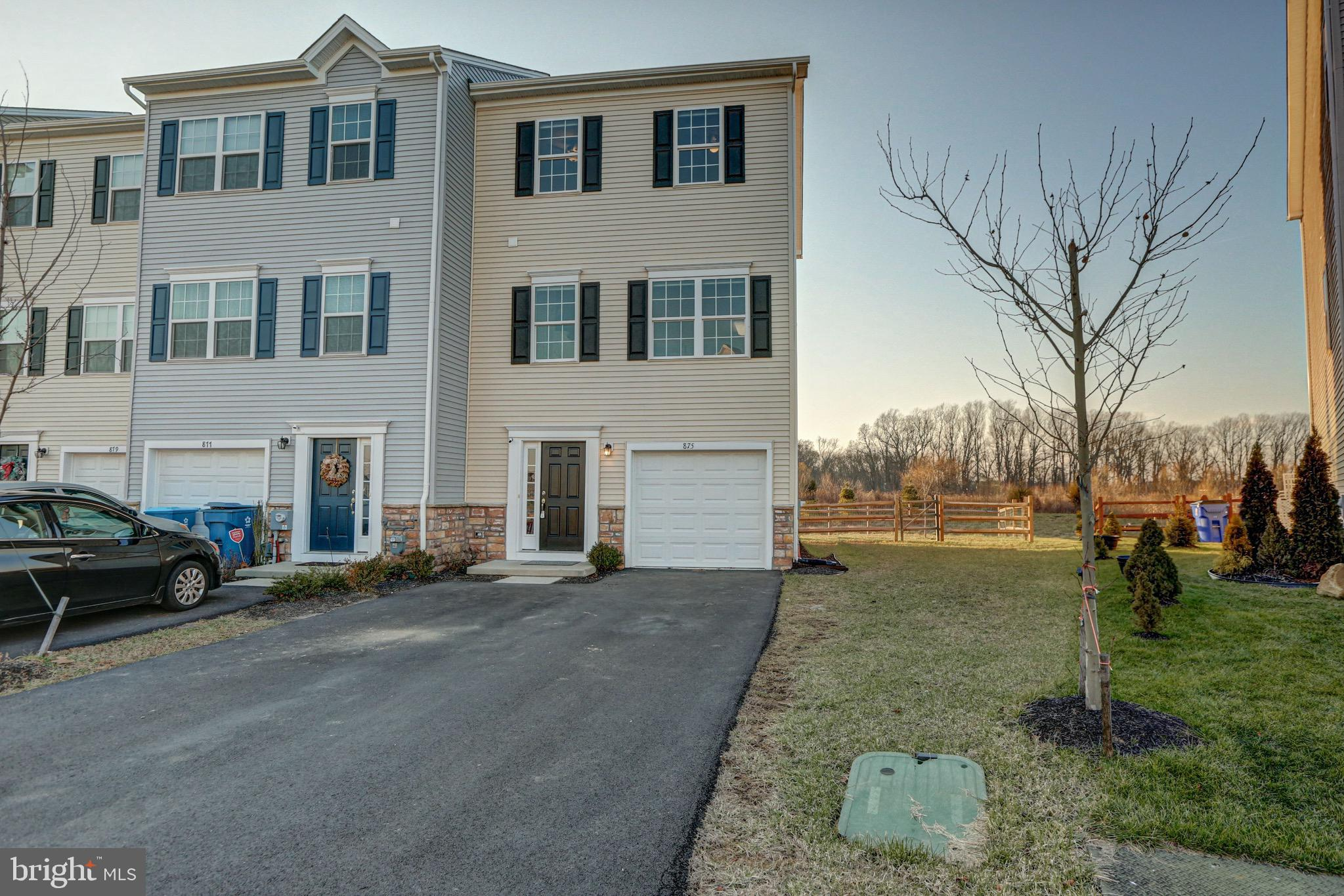 "Don't wait for new construction! Check out this gorgeous two year old town home in Hyett's Crossing now available! Located in north Middletown, this end-unit, 3-story home is priced to sell quickly and won't disappoint!  Outside, this home has a private driveway and one-car garage with plenty of storage space.   Enter level one into the foyer and you'll love the included storage shelves with lots of room for shoes, bags, and backpacks!  There is an unfinished storage room on also on this level that is drywalled and could easily be finished for recreational space.  Just outside the sliding glass door from this room is a paver patio and the rear yard is completely fenced in! Head up to level 2, which has your enormous open kitchen and family room area.  The kitchen has white 42"" cabinets, granite, stainless appliances and a large island.  There is another sliding glass door which leads to a maintenance free deck with fantastic sunset views.  Also on this level is a half bathroom!  Next up is level 3 where you have your 3 bedrooms and 2 full bathrooms as well as your laundry area!  Lots of features to enjoy in this home and in a great location! Come out today and get a glimpse before its SOLD!  *Private showings only due to COVID pandemic, please wear masks, sanitize before entering, and limit touching."