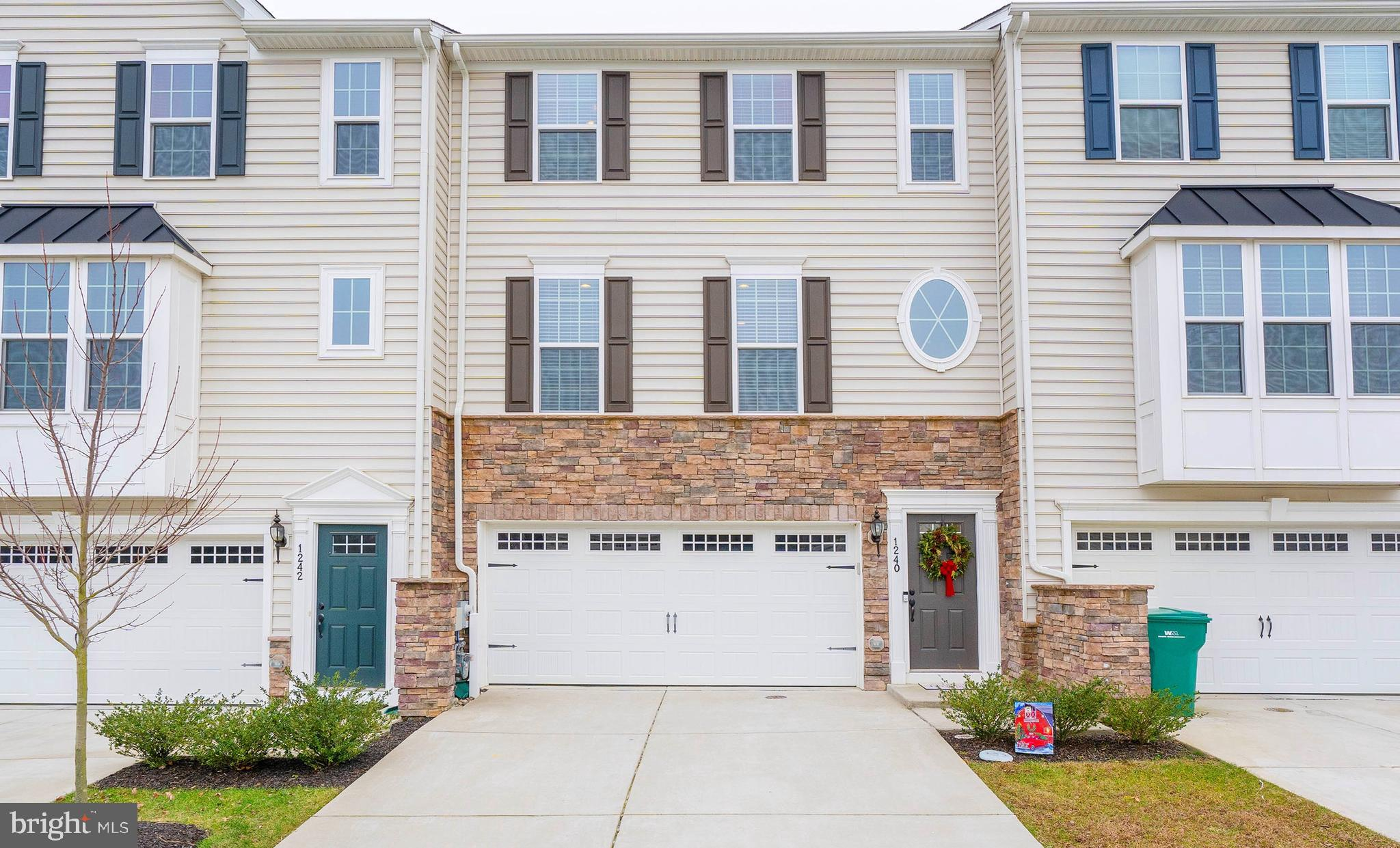 LIKE NEW - Built in 2017, this beautiful 3-Bedroom, 2.5-Bathroom Town Home is in pristine condition!  Located in a PRIME Middletown location & within the desirable Appoquinimink School District.  Arrive and you will notice the partial stacked-stone facade, a 2-CAR GARAGE, and plenty of parking space in the private driveway.  Enter into the foyer on the 1st level where you can go relax in the family room that walks out to the back yard or head up to the main level of the home. This home boasts 3 FULL LEVELS of above-ground living space!  The 2nd floor (main level) of the home features the living room, dining room, powder room, and kitchen.  You will find stunning HANDSCRAPED HARDWOOD FLOORS, tons of natural sunlight, recessed lighting, and neutral paint throughout.  The gourmet kitchen features; GRANITE countertops, STAINLESS STEEL APPLIANCES, gas cooking, a pantry, & an island.  A door from the dining area leads to the 2nd story LOW-MAINTENANCE VINYL DECK.  Head to the upper level where you will find 3 bedrooms, 2 full baths & the 3rd FLOOR LAUNDRY CLOSET (for added convenience!).  The master suite includes a WALK-IN CLOSET & a 5-PIECE MASTER BATHROOM.  The master bathroom features tile floors, a soaking tub, stall shower, double sinks & tile shower/tub surrounds.  Two additional bedrooms can be found down the hall, both spacious & with ceiling fans.  The 2nd bathroom is down the hall and features tile floors and a tile shower surround.  Don't forget about the bonus space you have here on the first floor, which could be used as a family room, entertainment space or even an oversized home office!  Built from the ground up just in 2017, this is your opportunity to own a home with ALL NEWER SYSTEMS & FIXTURES throughout - all without the wait and premiums for new construction!  ALL APPLIANCES ARE INCLUDED.  Do not wait, call today to schedule your tour before it's too late!