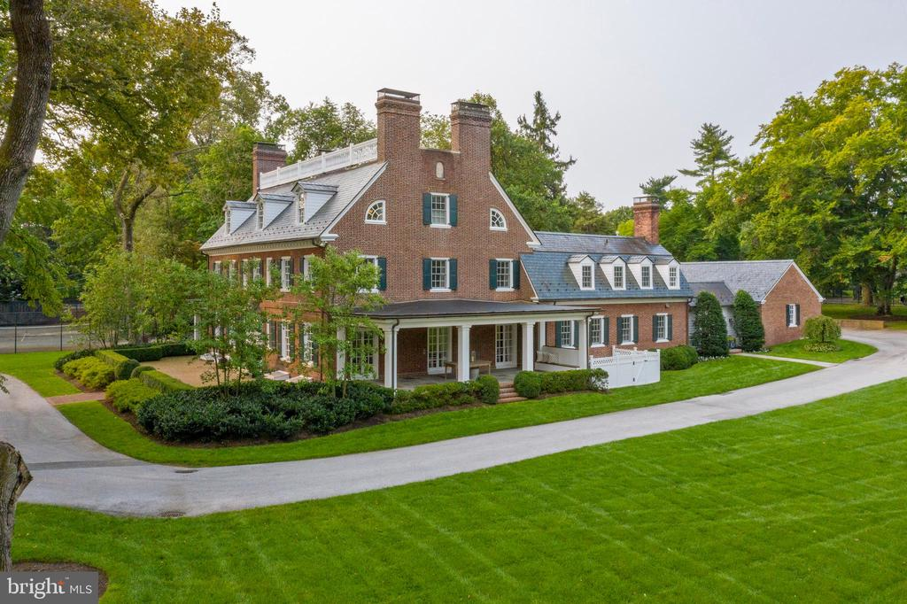 Town and Country living outside of Philadelphia. 375 N Spring Mill Rd is the perfect fusion of The Ultimate Location and the Ultimate in Luxury living. Located in the prestigious estate section of Villanova on Spring Mill Road, this gated oasis is situated in the very heart of Philadelphia's coveted Main Line. The property features over 2.5 flat and meticulously landscaped acres, a tennis court, mature old growth trees, and a spectacular antique brick herringbone entrance patio. Seamlessly blending old with new, the crown jewel of the outdoor space is the dramatic addition of a 1700 sq foot flagstone patio, complete with a 15 foot outdoor stone fireplace with hearthside seating, and built in grill. This stunning Georgian home offers the ultimate in lifestyle living. The tall, perfectly manicured rows of Arborvitae trees lining the property give the feeling of a hidden private enclave within, yet just outside its perimeter is immediate access to all that the Main Line has to offer. The property can be accessed easily from 2 driveways - the gated front entry off of Montgomery Avenue or the quiet private lane behind the house, off of Spring Mill Road. The prominent location is only nine miles from Philadelphia, and walkable to the Villanova train station, and so affords supreme convenience for traveling to Philadelphia or New York City and beyond. Originally part of the Walnut Hill estate, which still exists today, 1632 was divided into its own parcel in 1909. A historic plaque noting this date adorns the side of the home. With a gorgeous, stately entrance fronting Montgomery Avenue, the rear of the home offers a wonderful neighborhood feel. Down the small lane behind the house are eight other private homes for trick or treating or socializing. Just beyond the end of the lane is yet another family neighborhood with direct walking access to Villanova University, Bryn Mawr and more. Inside the home is updated to perfection, with large rooms that easily flow from one to t