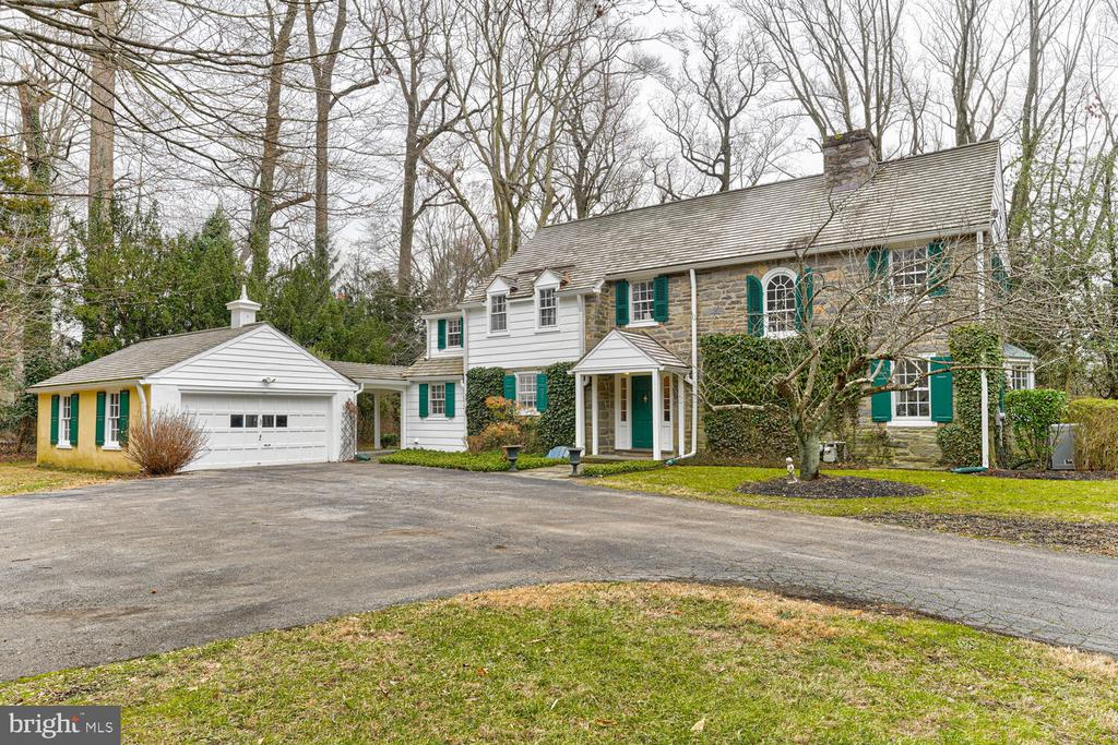 Classic and Charming Stone Colonial located in the sought after Estate Section of the Prestigious North Side Bryn Mawr. Perfect and Desirable Location at the End of the Cul-De-Sac and situated on a Private .84 Acre Lot. Just an easy walk to the center of Bryn Mawr and the Train Station, and nearby schools include Bryn Mawr College and the Baldwin School. This hidden gem has loads of character and is waiting for it's next owner to perform the updates and possible expansion whereby the smart equity investment will make this the Forever Home in one of the Main Line's most desirable neighborhoods. The first floor boasts a Spacious Living Room with wood burning fireplace and a Butler Pantry Style Granite Wet Bar with beverage refrigerator and ice maker. The Bonus Sun Room includes a classic brick floor and french doors overlooking the Spacious and Level Back Yard. The Formal Dining Room is ready for holiday dinners, and the Large and Cozy Family Room includes a gas stove, large TV, and doorway to the flagstone patio. The Kitchen includes a gas range, built in dishwasher,  ceramic backsplash, and leads to the convenient laundry room. The conveniently located Powder Room is just off the Classic Entrance Foyer. The second floor features a Spacious Owner's Bedroom Suite that includes an exterior balcony, walk in closet, and Owner's Bathroom with a marble top vanity and a hardwood floor. Bedroom's two and three are nice and spacious, and Bedroom four has it's own Full Bathroom. The Hall Bathroom and Second Staircase completes this floor, and there is a set of pull down stairs to a storage attic and the possibility to expand upwards. The Basement has plenty of room for storage, and the Two Car Detached Garage includes an open breezeway to protect you from rain leading to the side entrance.  The Majestic Back Yard offers Privacy and Serenity with plenty of room for outdoor recreation and social distance gatherings. With such a desirable and convenient location, and the endless 